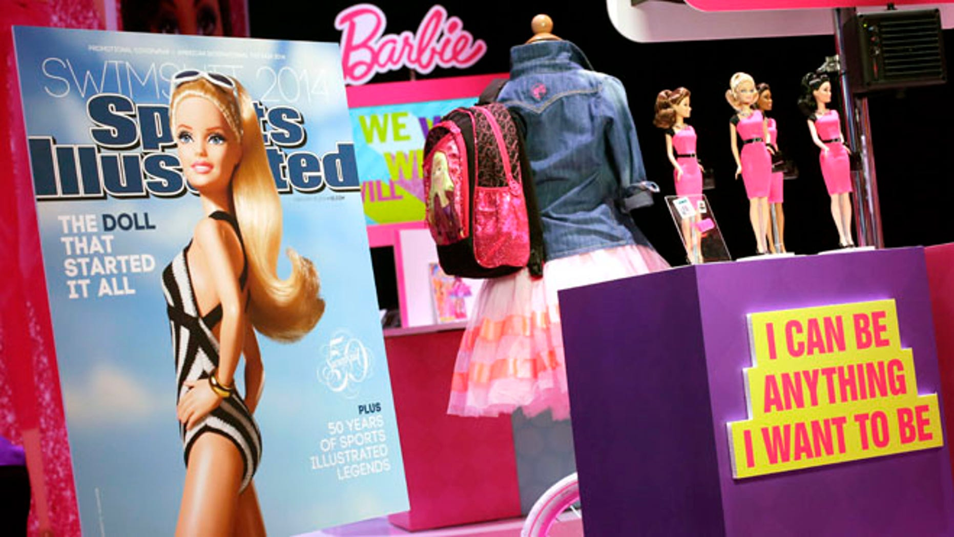 Feb. 14, 2014: In this file photo, a mock-up cover of Barbie on a Sports Illustrated swimsuit issue is displayed at the Mattel booth at the American International Toy Fair in New York.