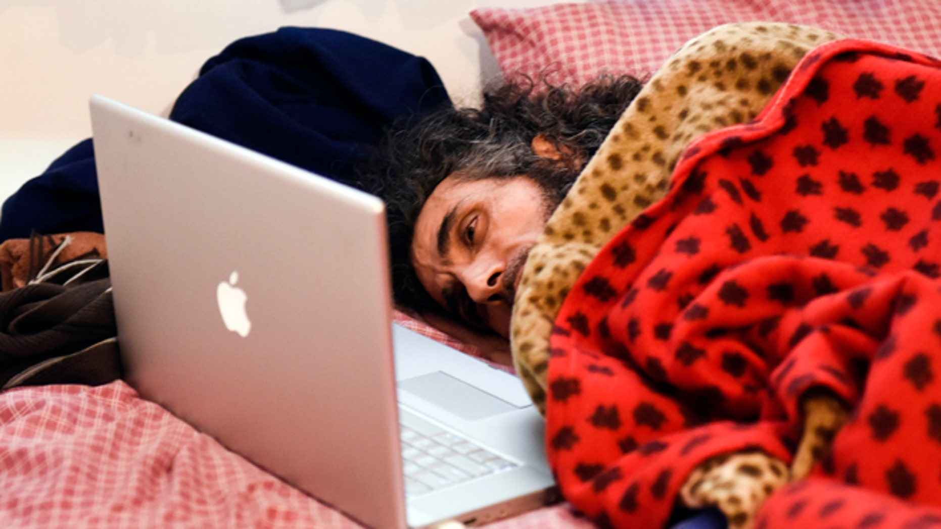 In this Friday, Sept. 9, 2016 photo, Syrian native Abu Wa'el Dhiab, a former Guantanamo detainee, rests in bed as he speaks to his family via a laptop, in his apartment in Montevideo, Uruguay. Activists and Uruguayan officials say the health of the former Guantanamo detainee resettled in the South American country is deteriorating as he continues a hunger strike at his home. Dhiab is demanding to leave Uruguay, which took him in with five other former Guantanamo prisoners in 2014. (AP Photo/Matilde Campodonico)