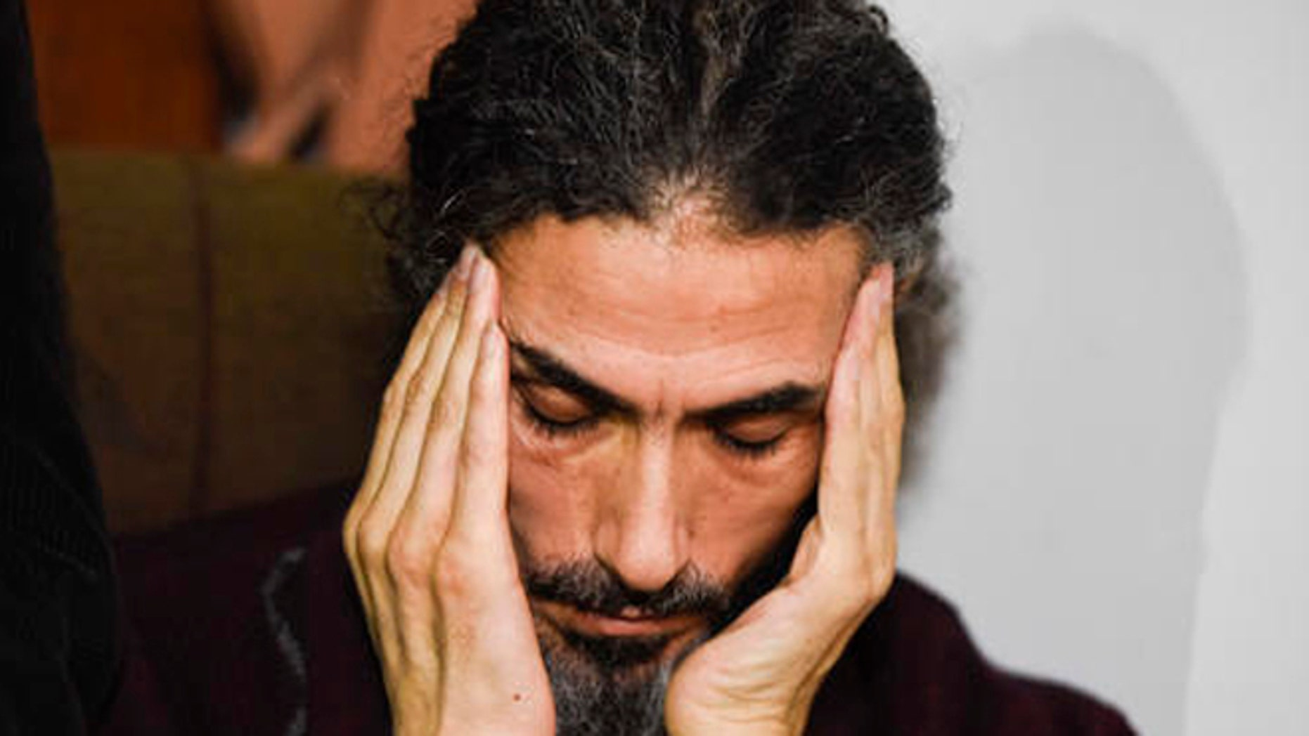 Former Guantanamo detainee Syrian Abu Wa'el Dhiab listens to a question as he holds a press conference at his apartment in Montevideo, Uruguay, Friday, Sept. 30, 2016. Uruguay's government says it is searching for another country to take Dhiab who is threatening to die on a hunger strike if he's not allowed to reunite with his family elsewhere. (AP Photo/Matilde Campodonico)