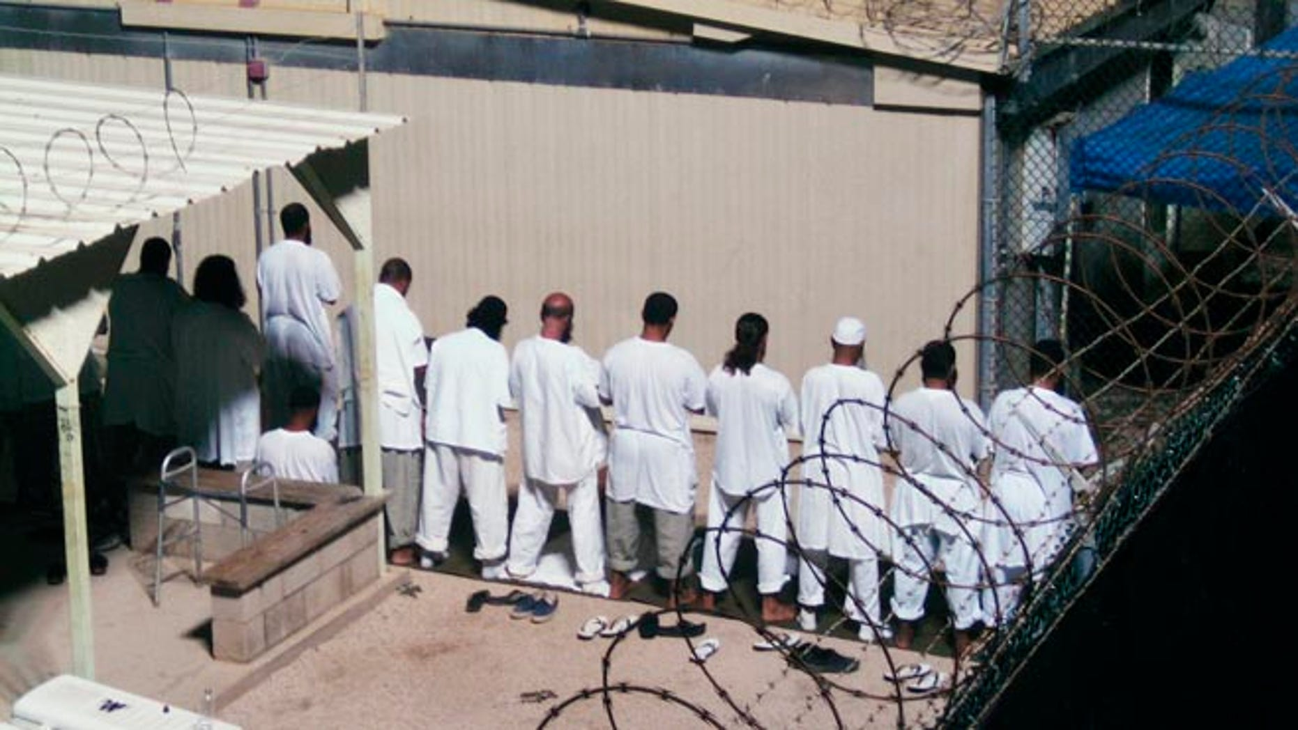 FILE: 2009: Detainees prayer at a detention facility at Guantanamo Bay U.S. Naval Base, in Cuba.