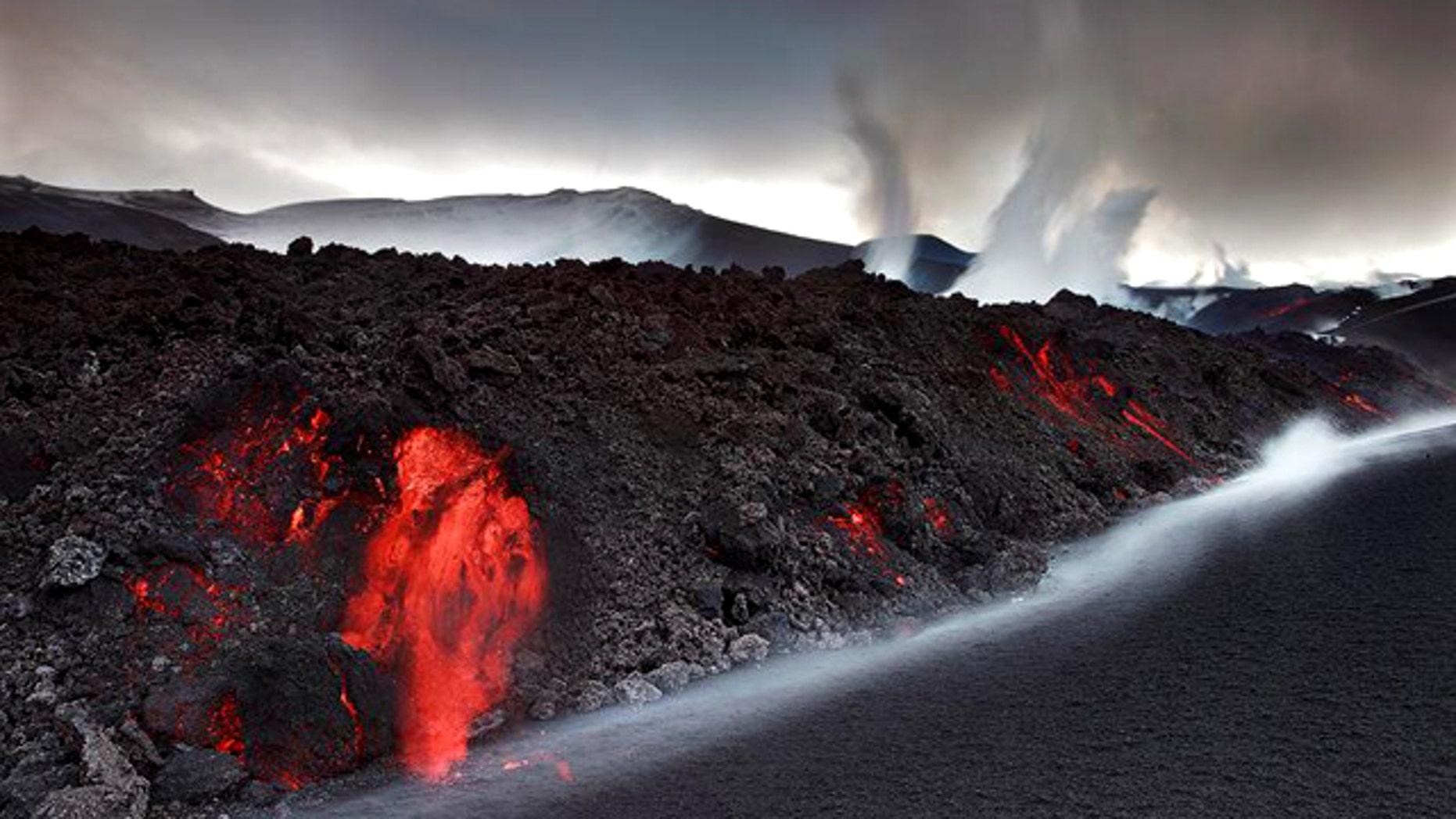 Smoke and steam from the volcano under the Eyjafjallajokull glacier in Iceland have forced hundreds of people to flee rising floodwaters and disrupted plane traffic across Europe.