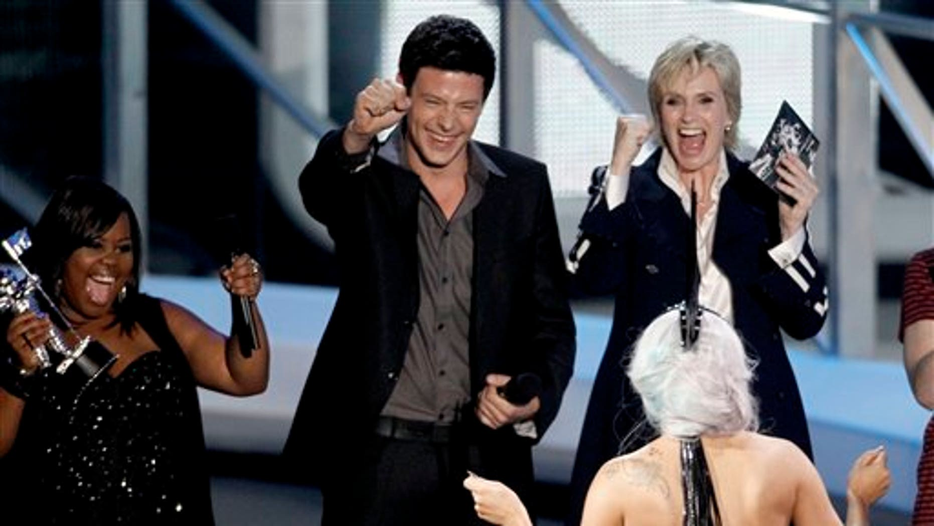 """From left, Amber Riley, Cory Monteith, and Jane Lynch, of the cast of Glee present Lady Gaga with the award for best pop video for """"Bad Romance"""" at the MTV Video Music Awards on Sunday, Sept. 12, 2010 in Los Angeles. (AP Photo/Matt Sayles)"""