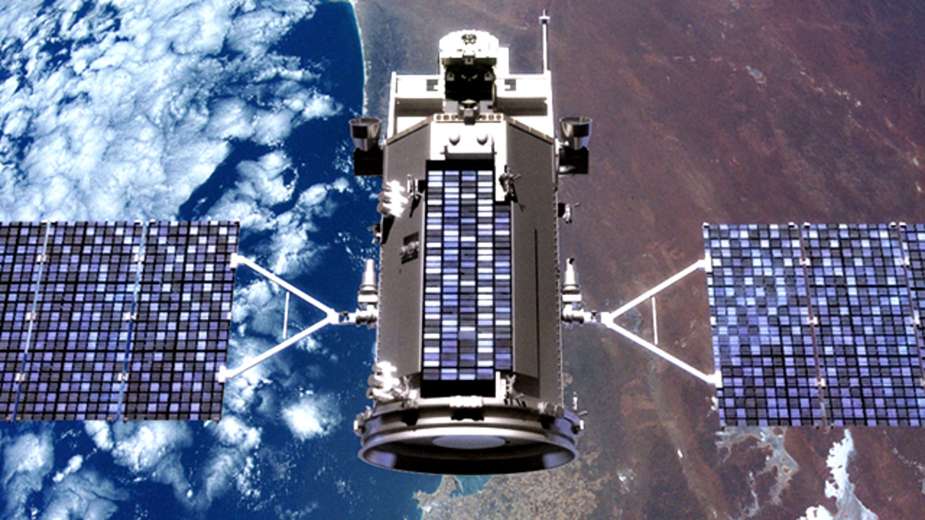 An illustration of the Glory satellite in orbit over the Earth.