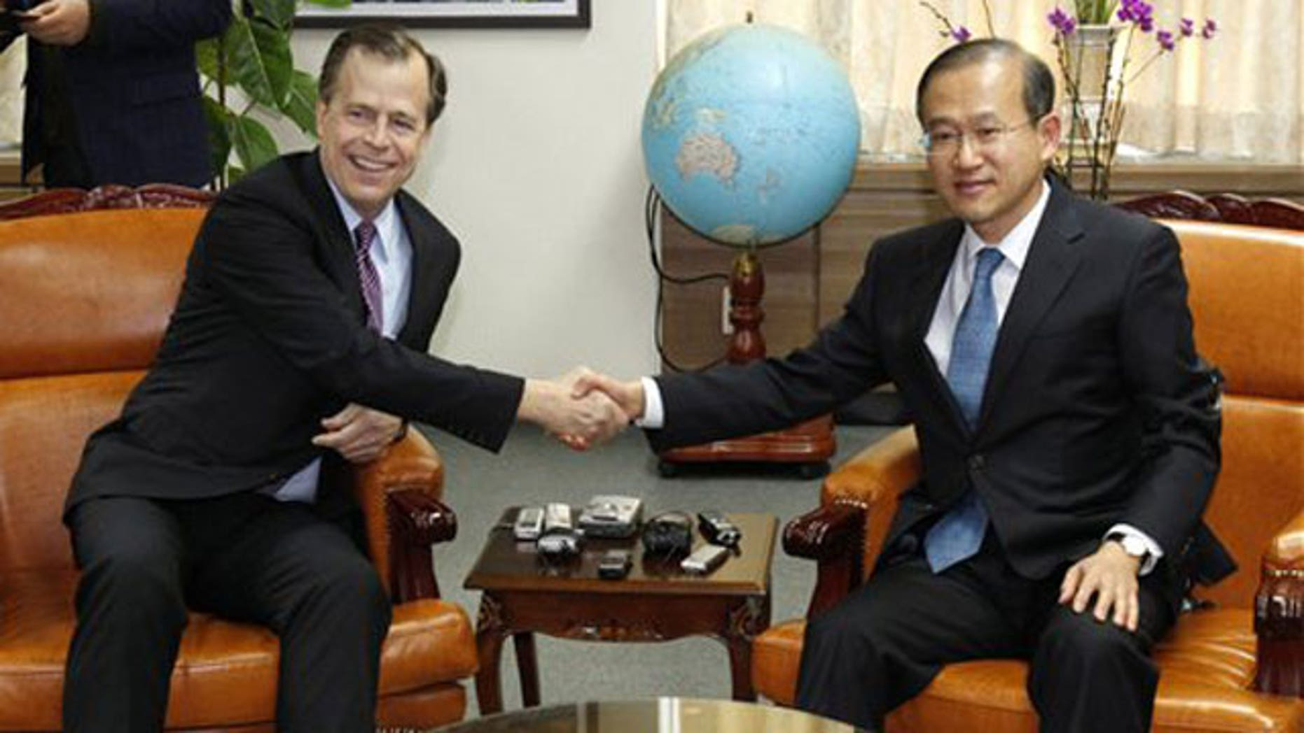Feb. 25, 2012: U.S. special representative on North Korea policy Glyn Davies, left, shakes hands with South Korea's nuclear envoy Lim Sung-nam during their meeting at the Foreign Ministry in Seoul, South Korea.