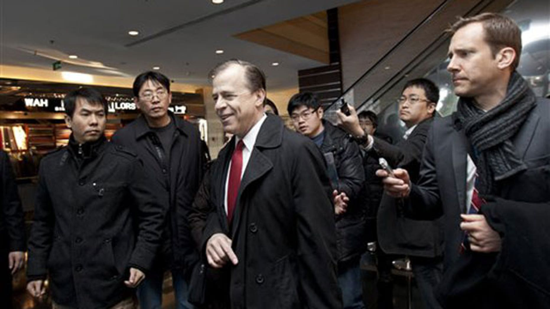 Feb. 23, 2012: U.S. envoy for North Korean Affairs Glyn Davies, center, is surrounded by journalists after giving a statement to media at a hotel in Beijing, China.