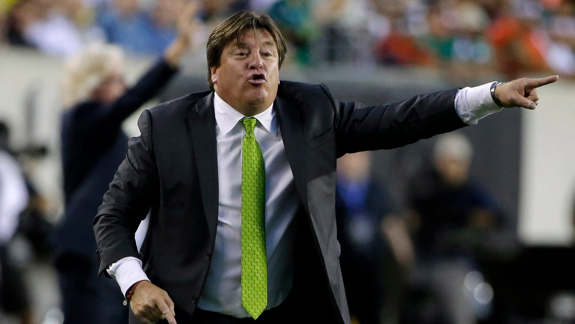 Mexico head coach Miguel Herrera yells during the first half of the CONCACAF Gold Cup championship soccer match against Jamaica, Sunday, July 26, 2015, in Philadelphia. (AP Photo/Matt Rourke)