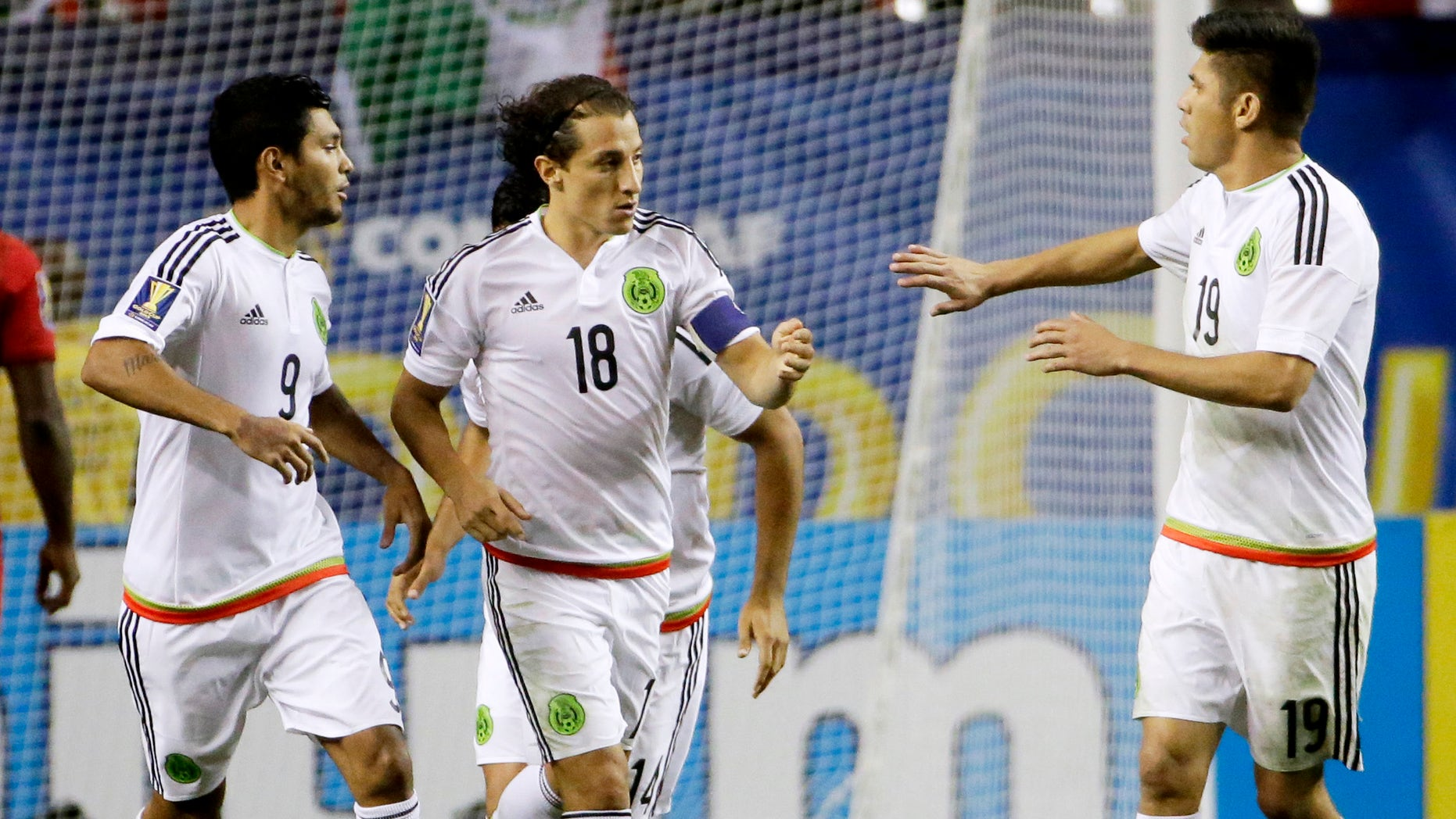 Mexicoâs Andres Guardado, center, is congratulated by teammates Jesus Corona, left, and Oribe Peralta after scoring on a penalty kick during the second half of a CONCACAF Gold Cup soccer semifinal against Panama on Wednesday, July 22, 2015, in Atlanta. (AP Photo/David Goldman)