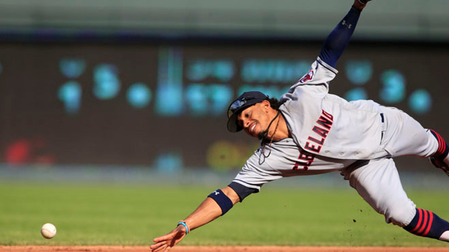 FILE - In this Oct. 1, 2016, file photo, Cleveland Indians shortstop Francisco Lindor dives for a ground ball hit by Kansas City Royals' Drew Butera during a baseball game at Kauffman Stadium in Kansas City, Mo. Lindor won a Gold Glove award, announced Tuesday, Nov. 8, by Rawlings. He is a first-time winner. (AP Photo/Orlin Wagner, File)