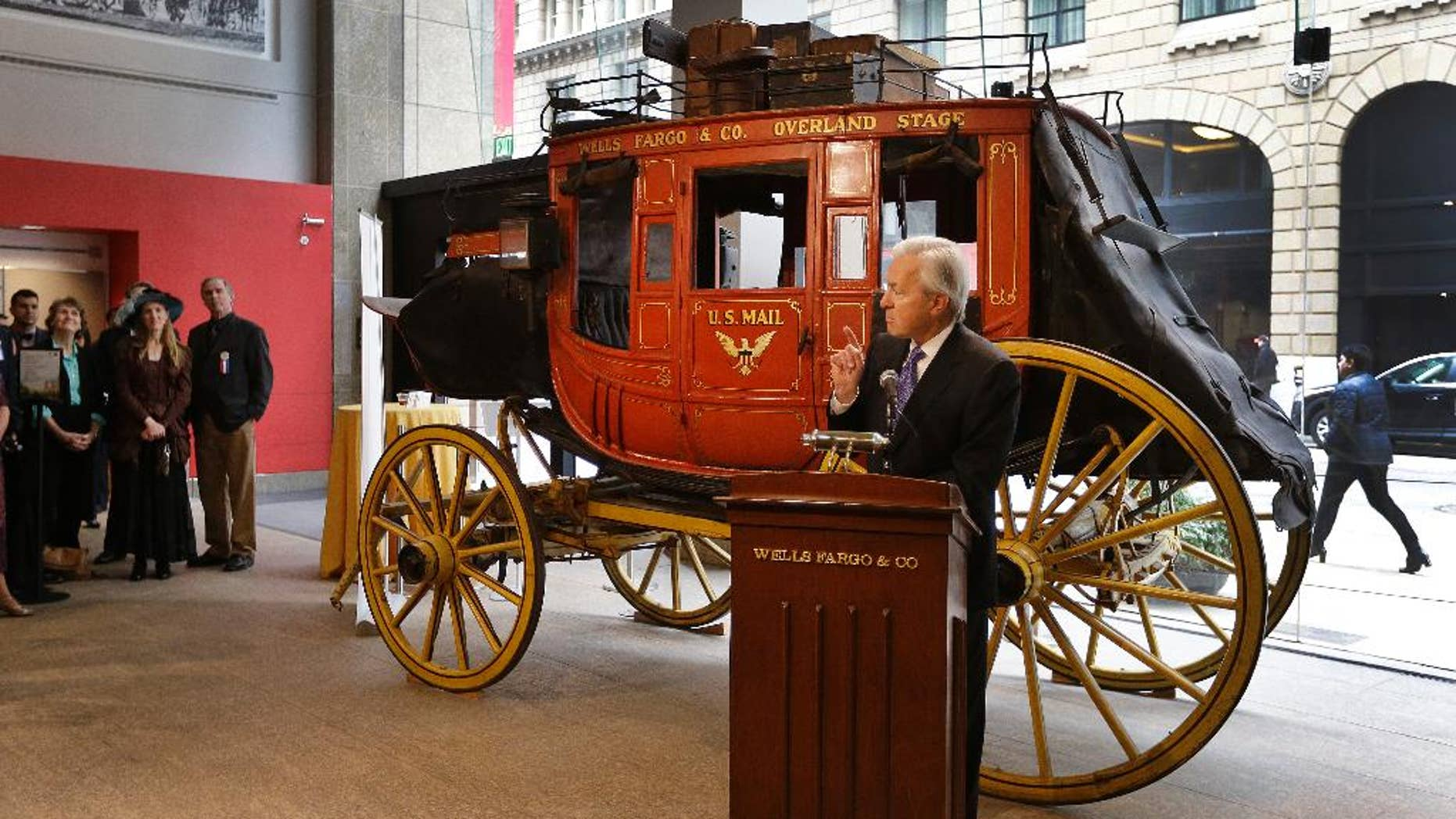 Wells Fargo CEO John Stumpf gestures while speaking during a media conference Thursday, Feb. 19, 2015, in San Francisco.  The popular history museum in the heart of San Francisco's financial district is reopening weeks after thieves smashed a stolen vehicle through its front door and made off with historic gold nuggets on display.  (AP Photo/Ben Margot)