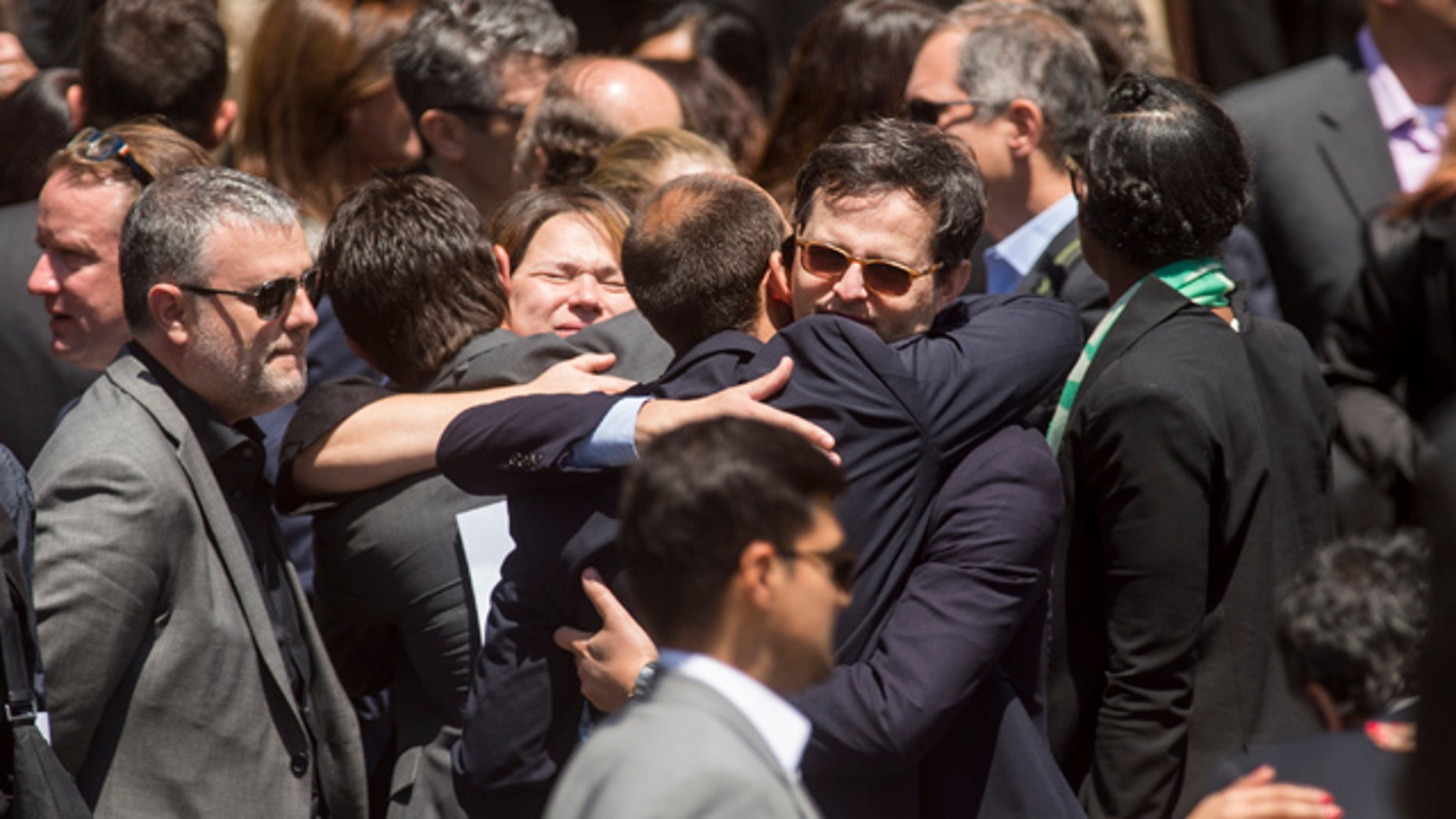 May 5, 2015: Mourners leave a memorial service for SurveyMonkey CEO David Goldberg on Tuesday, May 5, 2015, in Stanford, Calif. Goldberg, the 47-year-old husband of 'Lean In' author and Facebook executive Sheryl Sandberg, died in an accident while exercising at a Mexican vacation resort on Friday, May 1. Authorities say he apparently slipped on a treadmill and struck his head. (AP Photo/Noah Berger)