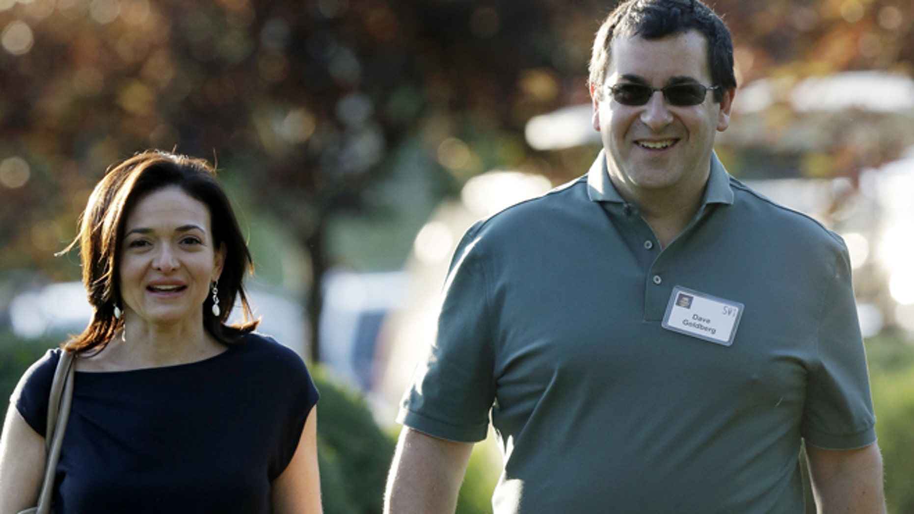 July 10, 2013: In this file photo, Sheryl Sandberg, COO of Facebook, left, and her husband David Goldberg, CEO of SurveyMonkey, walk to the morning session at the Allen & Company Sun Valley Conference in Sun Valley, Idaho.