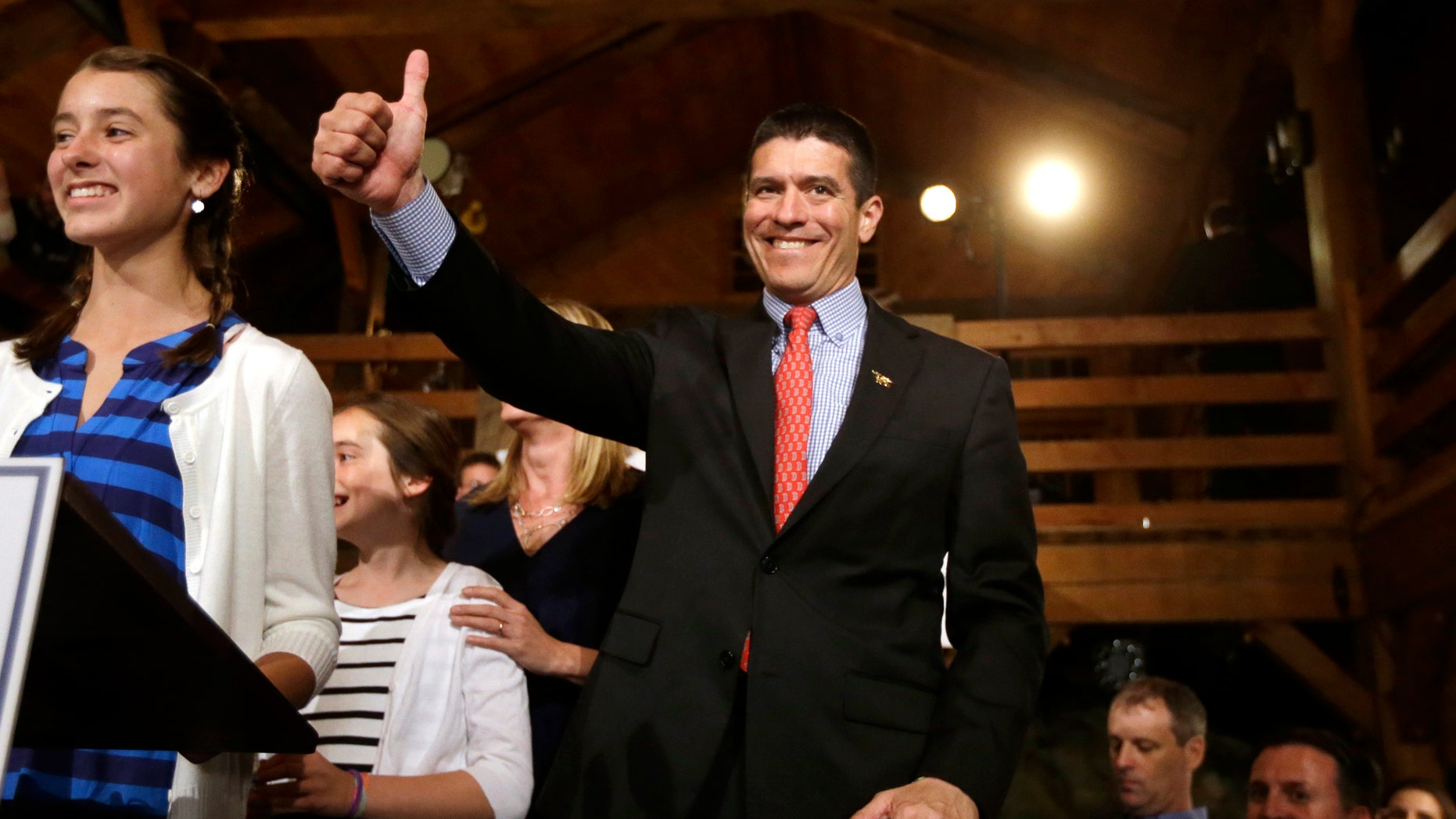 Republican candidate for the U.S. Senate Gabriel Gomez, center, gives a thumbs up as he takes to the stage next to his daughter Olivia, 13, left, before addressing an audience with a victory speech at a watch party, in Cohasset, Mass., Tuesday, April 30, 2013. Gomez won his primary bid for the Republican nomination to contest a U.S. Senate seat, defeating Republican hopefuls Michael Sullivan and Dan Winslow. (AP Photo/Steven Senne)