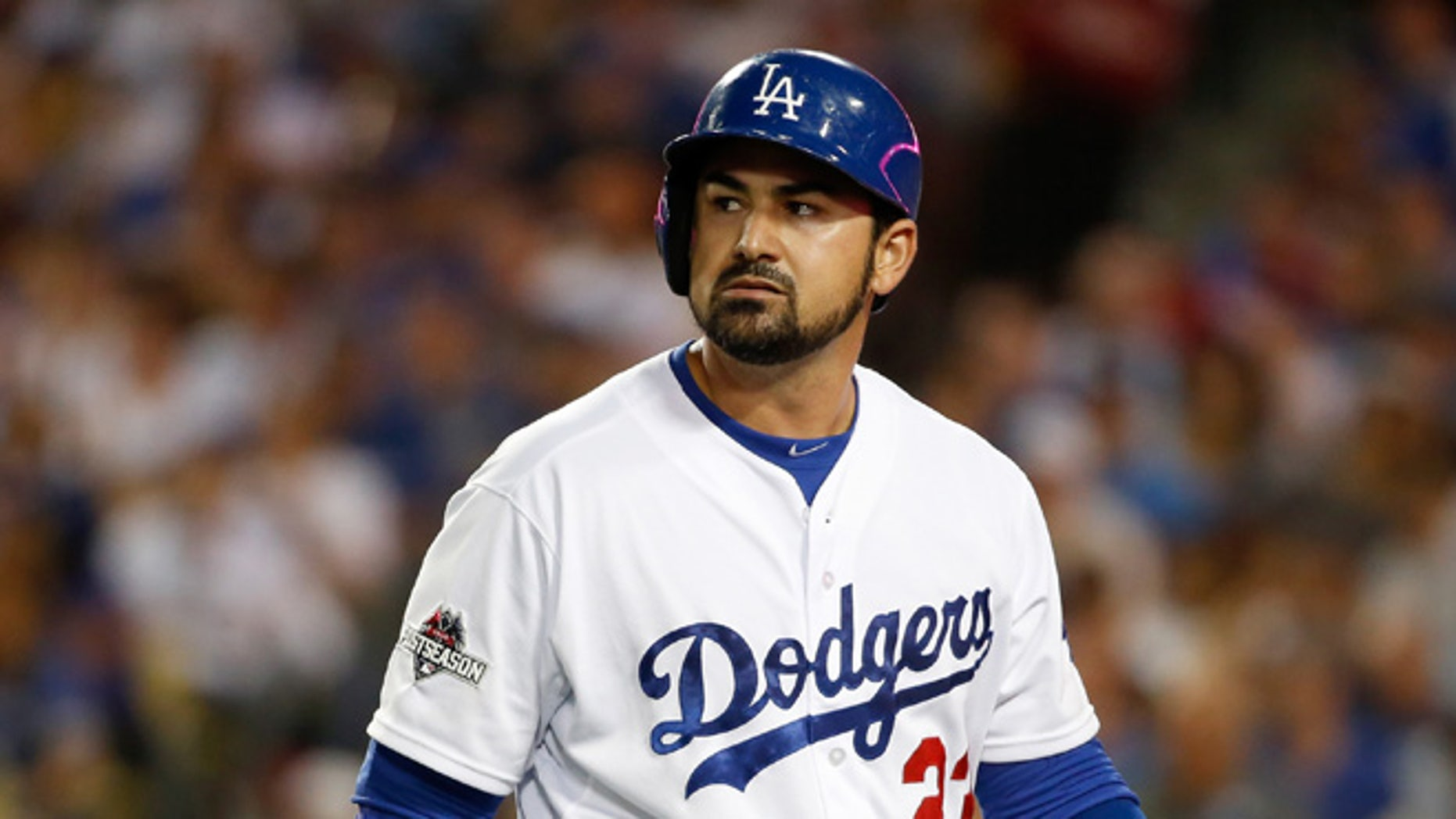 Adrian Gonzalez of the Los Angeles Dodgers reacts after striking out in the fifth inning against the New York Mets in game five of the National League Division Series at Dodger Stadium on October 15, 2015 in Los Angeles, California.  (Photo by Sean M. Haffey/Getty Images)