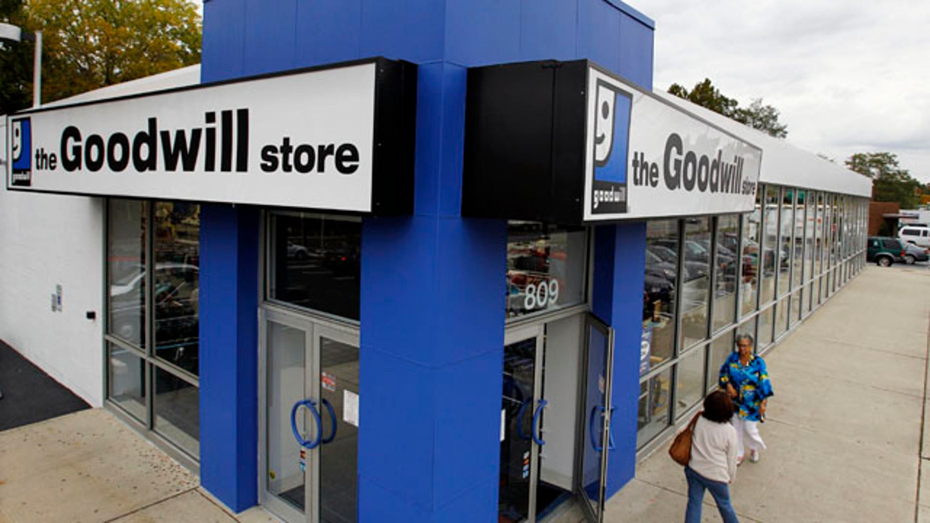 Oct. 14: Shoppers go into a Goodwill store in Paramus, N.J. The Paramus store is one of 100 new locations for the non-profit chain--many are in middle-class suburbs.