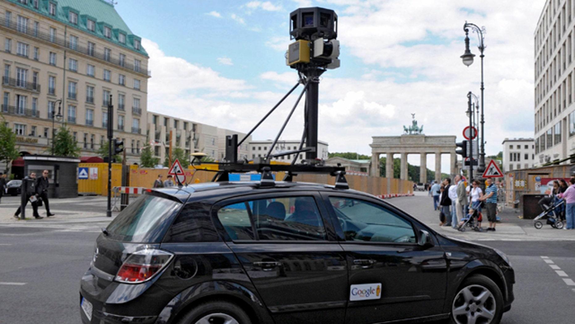 A Google Street View car drives near the Brandenburg Gate in Berlin, Germany.