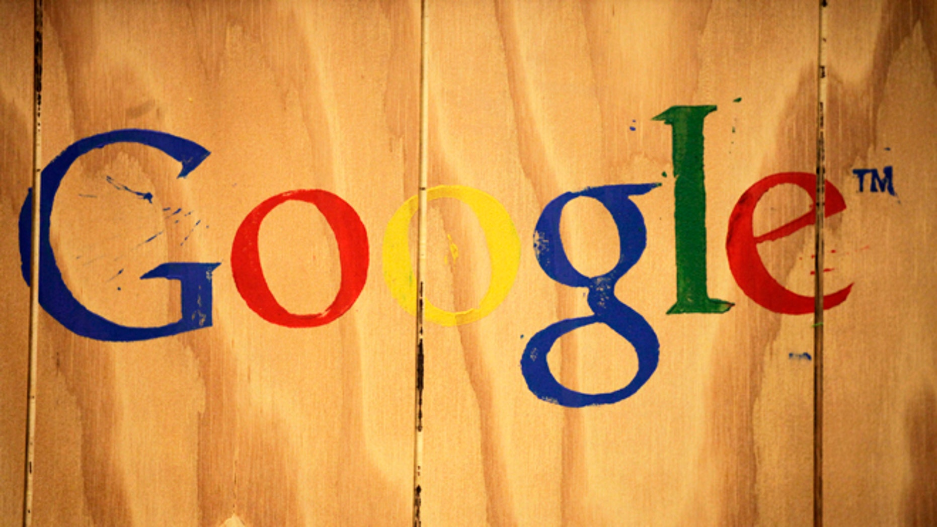 A Google logo is painted on the side of a plywood box at Google offices in New York.