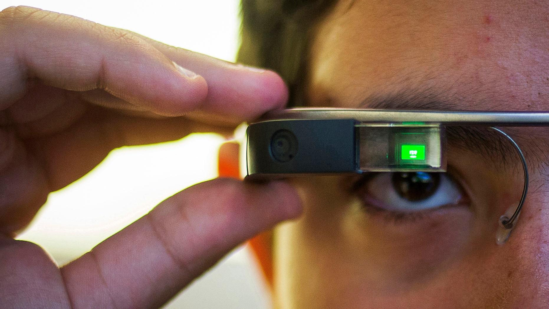 File photo - Tiago Amorim of Brazil, poses with a Google Glass eyewear frame in Manhattan, New York Sept. 19, 2014.