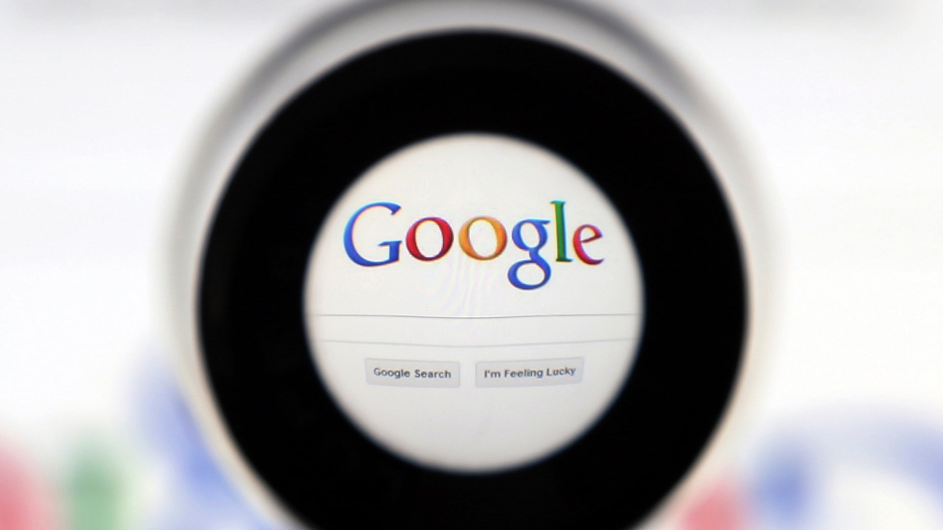 A Google search page is seen through a magnifying glass in this photo illustration taken in Brussels May 30, 2014. Google has taken the first steps to meet a European ruling that citizens can have objectionable links removed from Internet search results, a ruling that pleased privacy campaigners but raised fears that the right can be abused to hide negative information.   REUTERS/Francois Lenoir (BELGIUM - Tags: SCIENCE TECHNOLOGY POLITICS) - RTR3RK8U