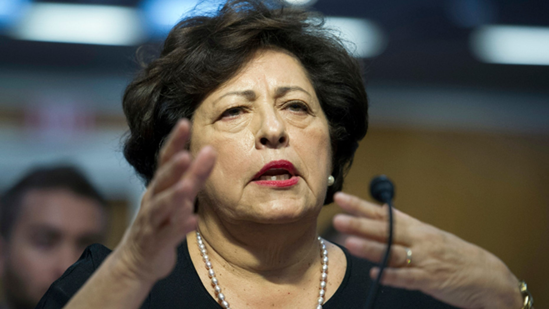 Katherine Archuleta, director, Office of Personnel Management, gestures while she testifies before the Senate Appropriations subcommittee on Financial Services and General Government hearings to review IT spending and date security at the Office of Personnel Management  in Washington, Tuesday, June 23, 2015. (AP Photo/Cliff Owen)