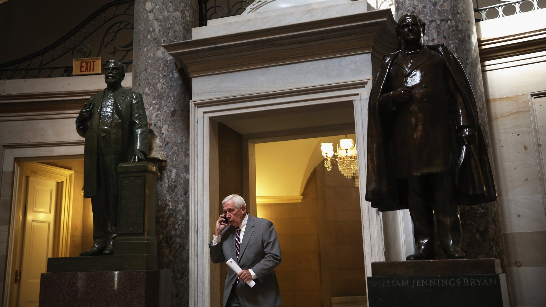 WASHINGTON, DC - OCTOBER 03:  U.S. Rep. Frank Wolf (R-VA) talks on his cellular phone as he passes through the Statuary Hall at the Capitol October 3, 2013 on Capitol Hill in Washington, DC. (Photo by Alex Wong/Getty Images)