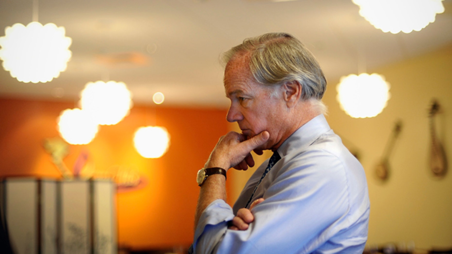 In this Thursday, Sept. 18, 2014 photo, Republican candidate for Connecticut governor Tom Foley listens to a business owner during a campaign stop in Middletown, Conn.