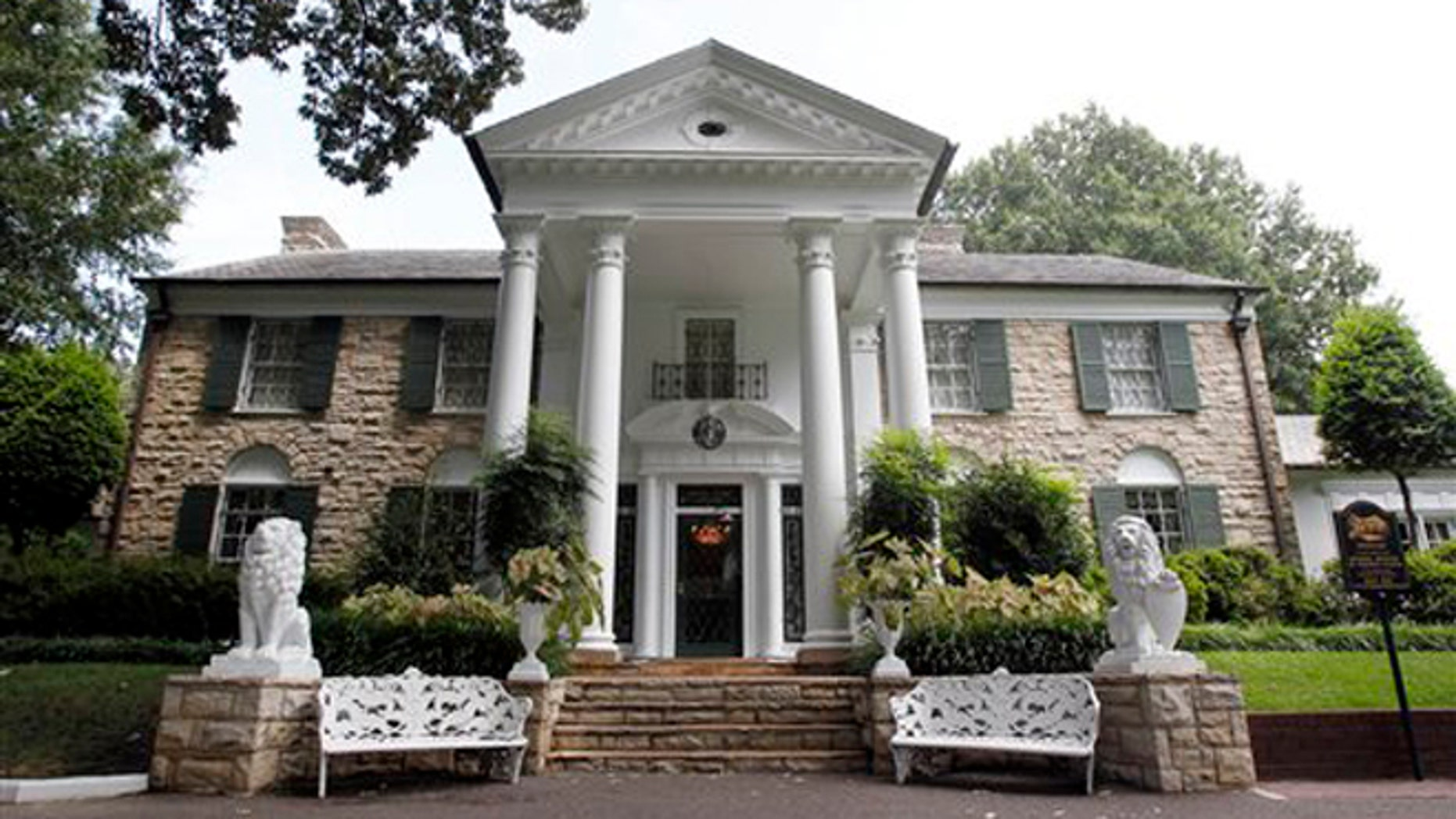 FILE -- This  Aug. 2010 photo shows Graceland, Elvis Presley's home in Memphis, Tenn. Graceland opened for tours on June 7, 1982. They sold out all 3,024 tickets on the first day and didn't look back, forever changing the Memphis tourist landscape while keeping Elvis and his legend alive.(AP Photo/Mark Humphrey)