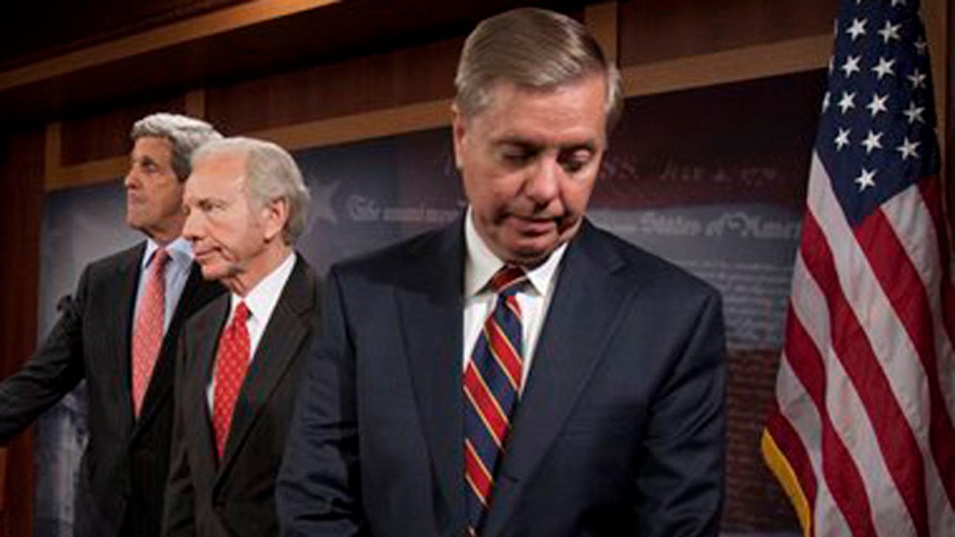 Sen. John Kerry, D-Mass., Sen. Joseph Lieberman, I-Conn., and Sen. Lindsey Graham, R-S.C. take part in a news conference on Capitol Hill in Washington, Wednesday, Nov. 4, 2009 (AP)