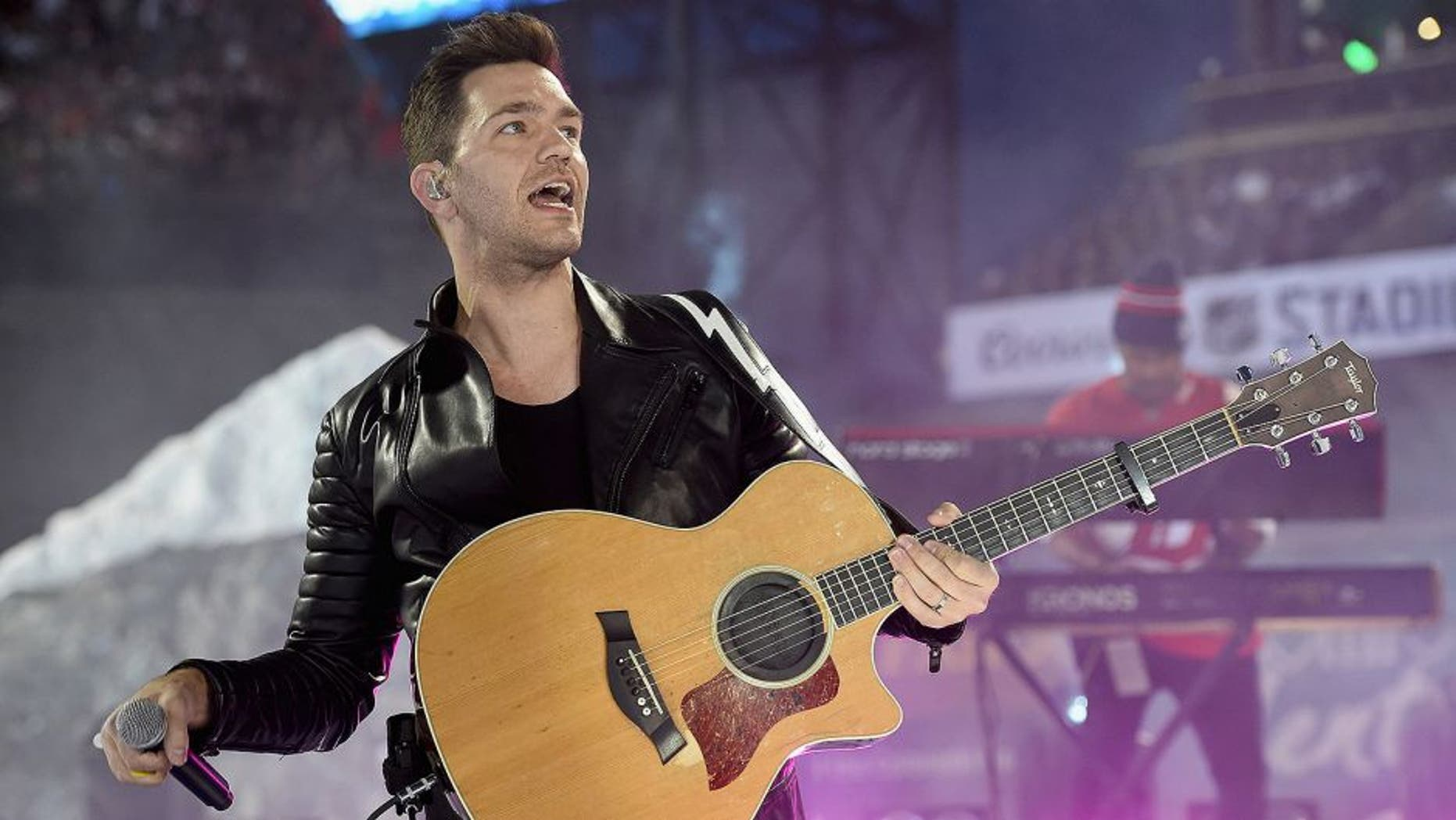 DENVER, CO - FEBRUARY 27: Recording artist Andy Grammer performs during pregame of the 2016 Coors Light Stadium Series game between the Detroit Red Wings and the Colorado Avalanche at Coors Field on February 27, 2016 in Denver, Colorado. (Photo by Brian Babineau/NHLI via Getty Images)
