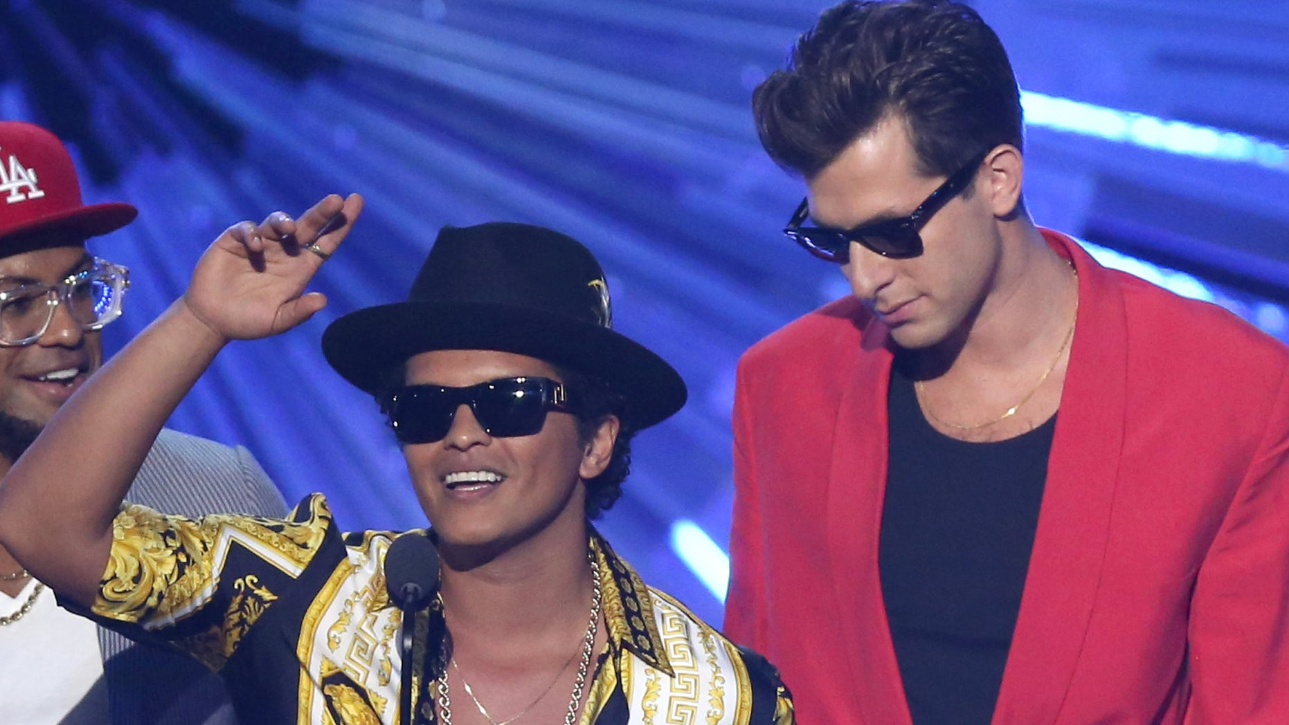 """FILE - In this Aug. 30, 2015, file photo, Bruno Mars, left, and Mark Ronson accept the award for male video of the year for âUptown Funkâ at the MTV Video Music Awards in Los Angeles. Ronson and Mars' """"Uptown Funk"""" is one of the nominees for record of the year at the Grammys on Feb. 15, 2016. (Photo by Matt Sayles/Invision/AP, File)"""