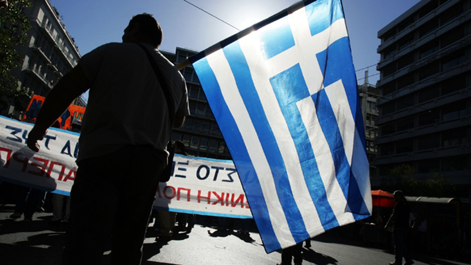 ATHENS, GREECE - NOVEMBER 6:  Protesters march outside parliament during a rally on November 6, 2012 in Athens, Greece. Thousands of Greeks are protesting against further austerity measures as a two-day general strike begins ahead of a crucial Parliamentary vote for emergency cuts and tax increases.  (Photo Milos Bicanski/Getty Images)
