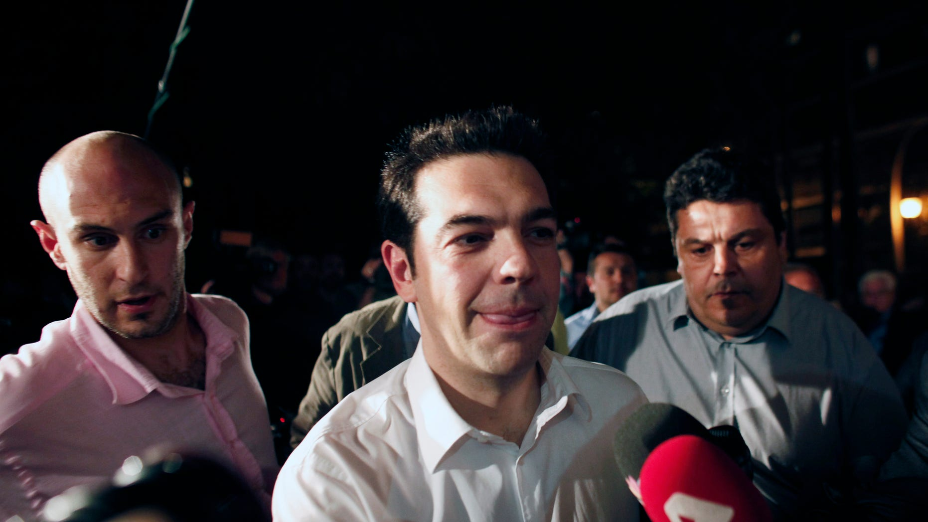 May 6, 2012: Greek leader of Coalition of the Radical Left party (SYRIZA) Alexis Tsipras arrives at the headquarters of his party in Athens.