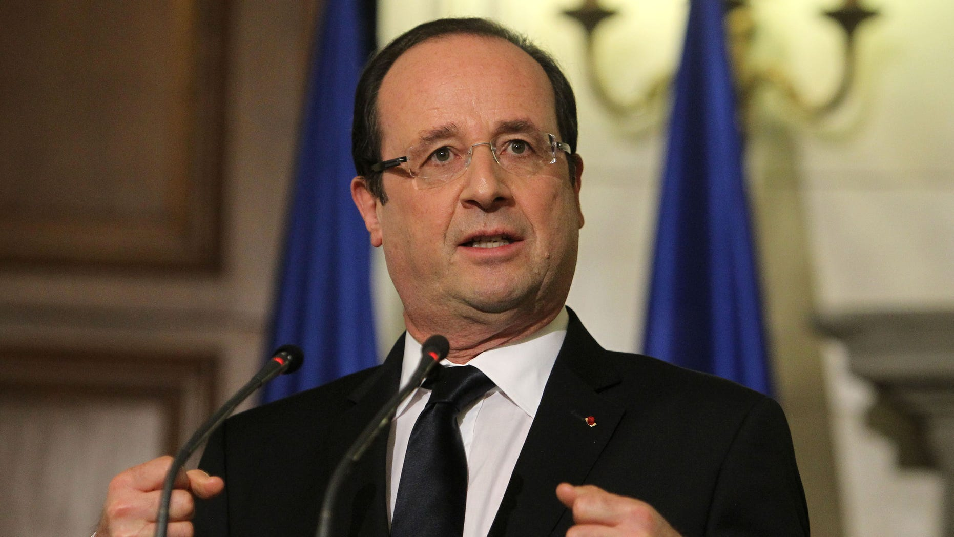 Feb. 19, 2013 -FILE photo of French President Francois Hollande speaks at a  news conference in Athens.