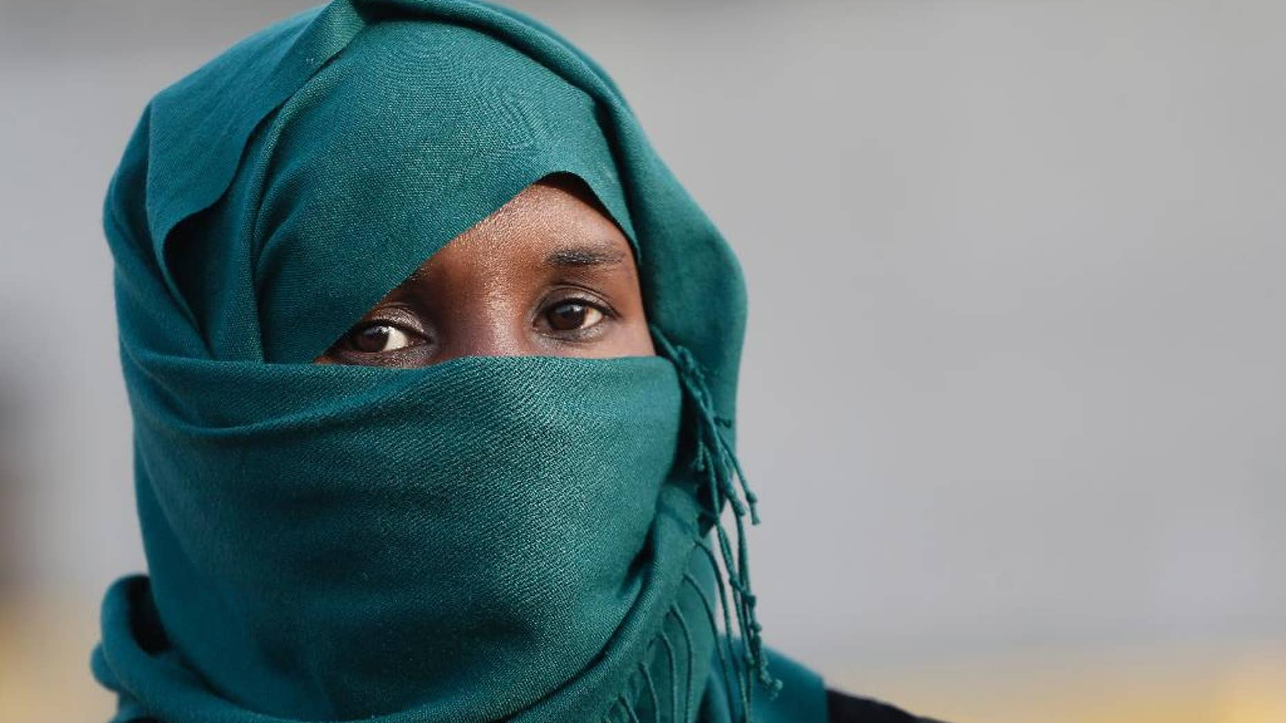 An African immigrant, one of the 32 from Syria and Somalia who survived from one of the deadliest migrant boat accidents which occurred on May 5 in Greek waters, arrives at the port of Piraeus, near Athens, on Monday, May 12, 2014. At least 22 people, including families trapped in a flooded cabin, drowned when a yacht and a dinghy crammed with migrants trying to slip into Greece capsized last week in the eastern Aegean Sea, next to the island of Samos, authorities said. (AP Photo/Petros Giannakouris)