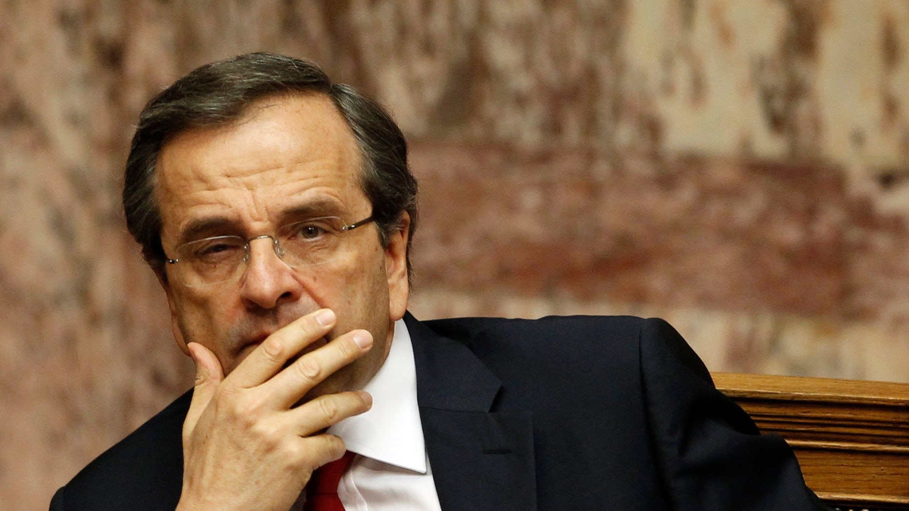 Greek Prime Minister Antonis Samaras looks on during a debate on the new government's policy agenda before staging a vote of confidence  at the parliament in Athens, late Sunday July 8, 2012. (AP Photo/Kostas Tsironis)