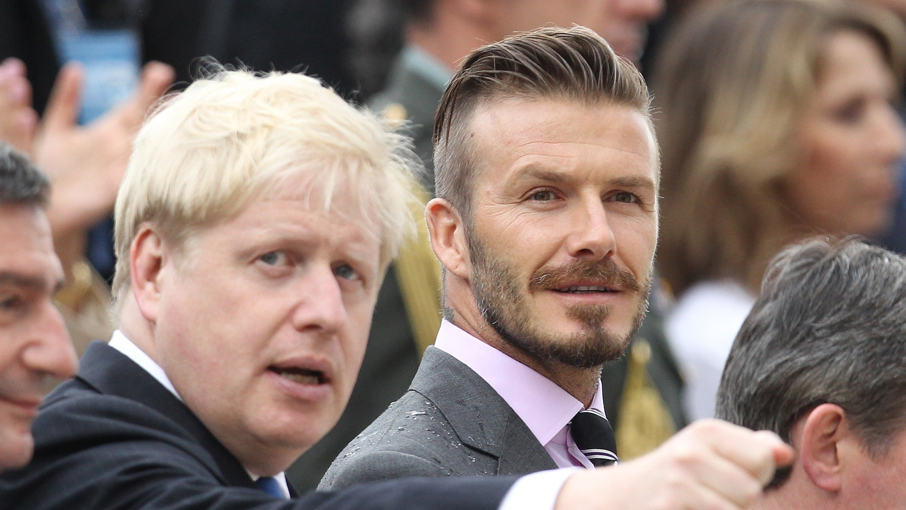 May 17, 2012: Former England football captain David Beckham, right, and London Mayor Boris Johnson attend a handover for the Olympic flame at Panathenaean stadium in Athens.