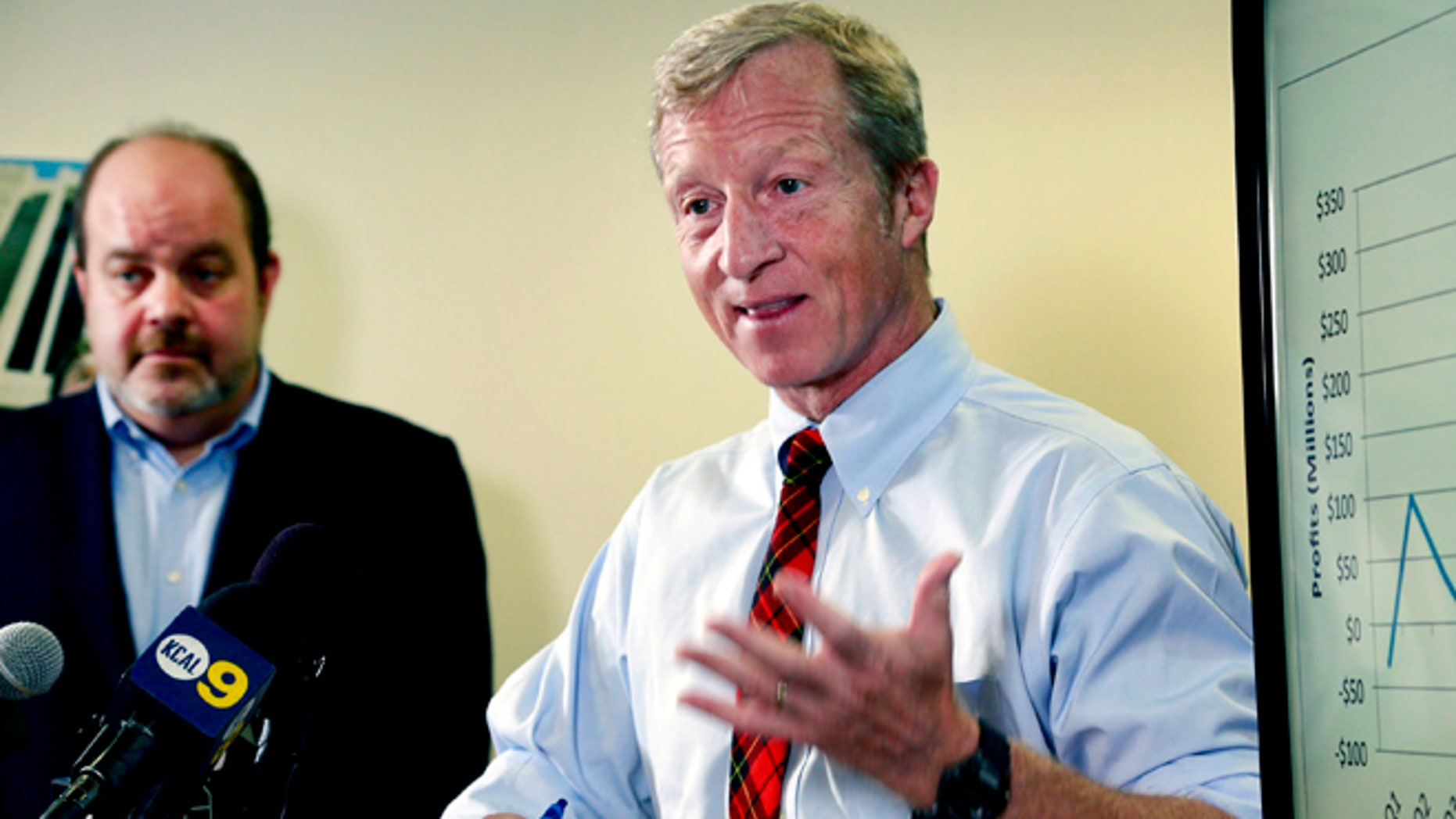 Billionaire climate activist Tom Steyer, right, speaks during a news conference with consumer advocate Jamie Court, left, president of Consumer Watchdog in Santa Monica, Calif.