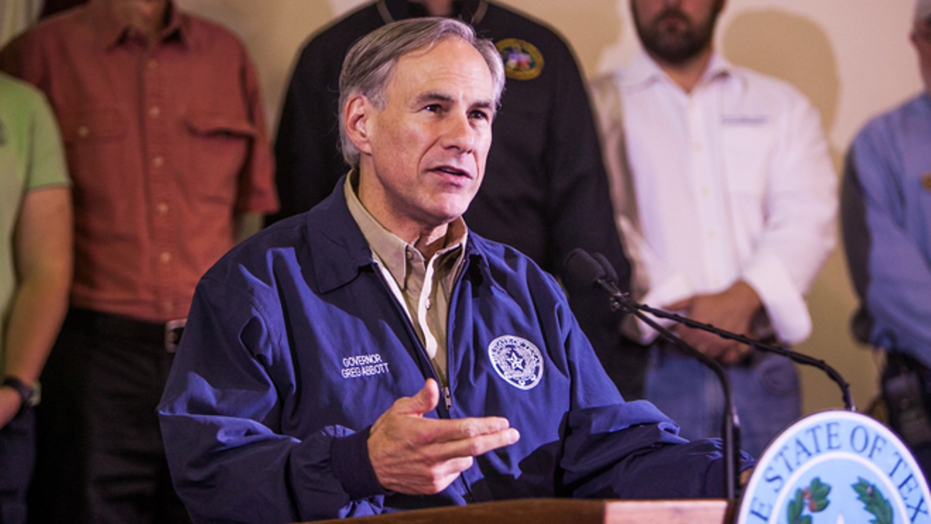 Texas Gov. Greg Abbott speaks at a news conference on May 25, 2015 in Wimberly, Texas. (Photo by Drew Anthony Smith/Getty Images)