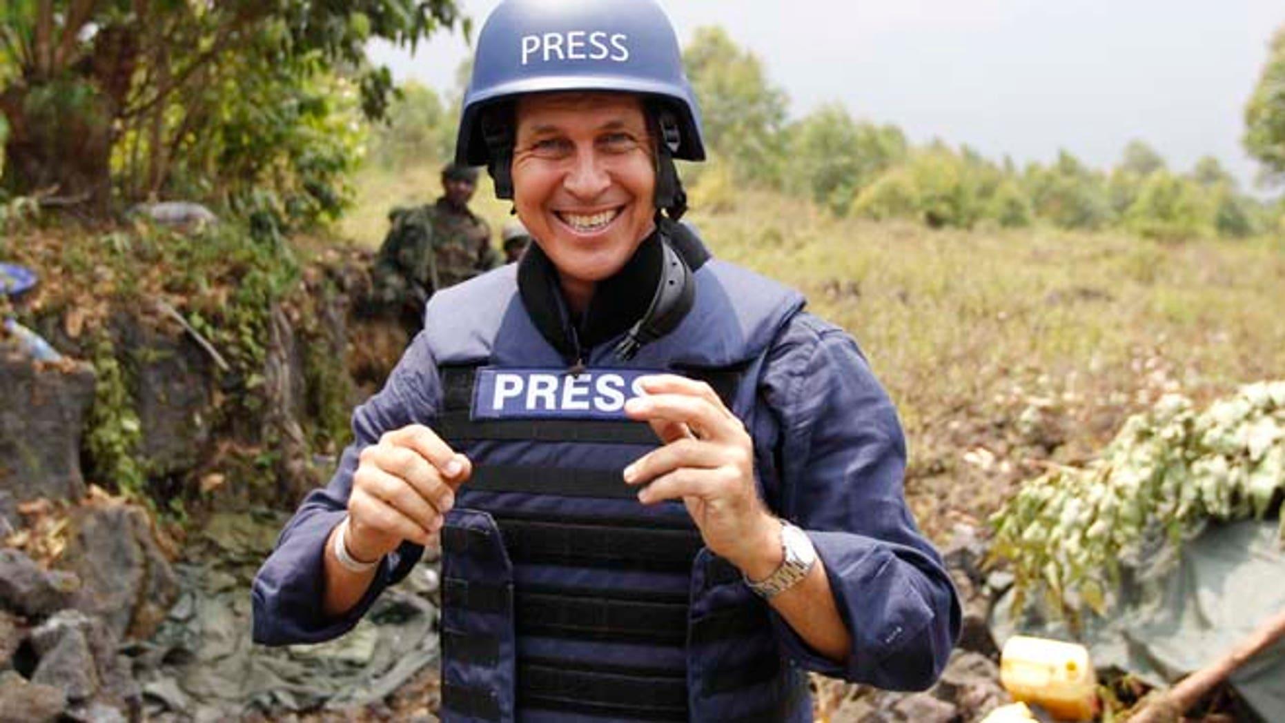 Aug. 7, 2013: Al Jazeera journalist Peter Greste poses for a photograph in Kibati village, near Goma in the eastern Democratic Republic of Congo. (Reuters)