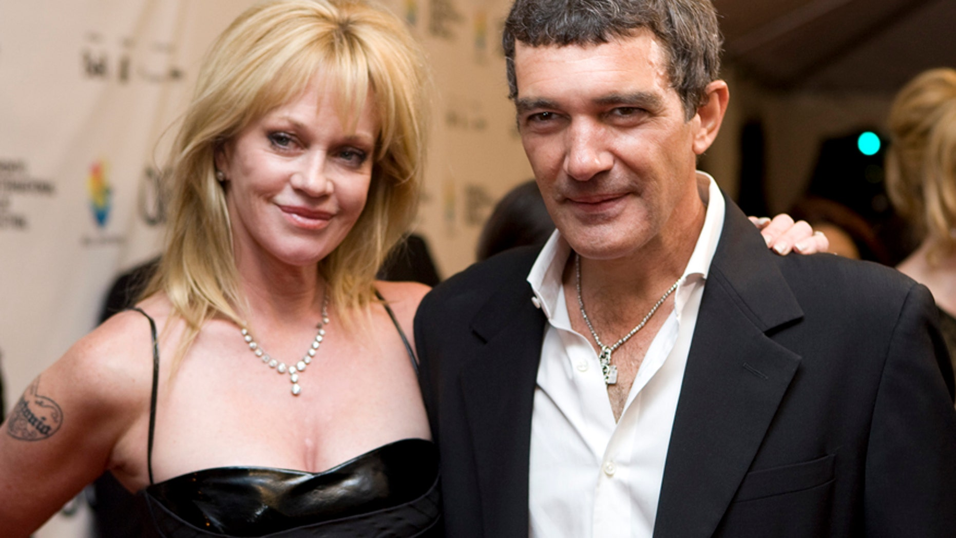 """This Sept. 7, 2008 file photo shows actors Antonio Banderas, right, and his wife Melanie Griffith at the gala premiere of """"The Other Man"""" at the Toronto International Film Festival in Toronto."""