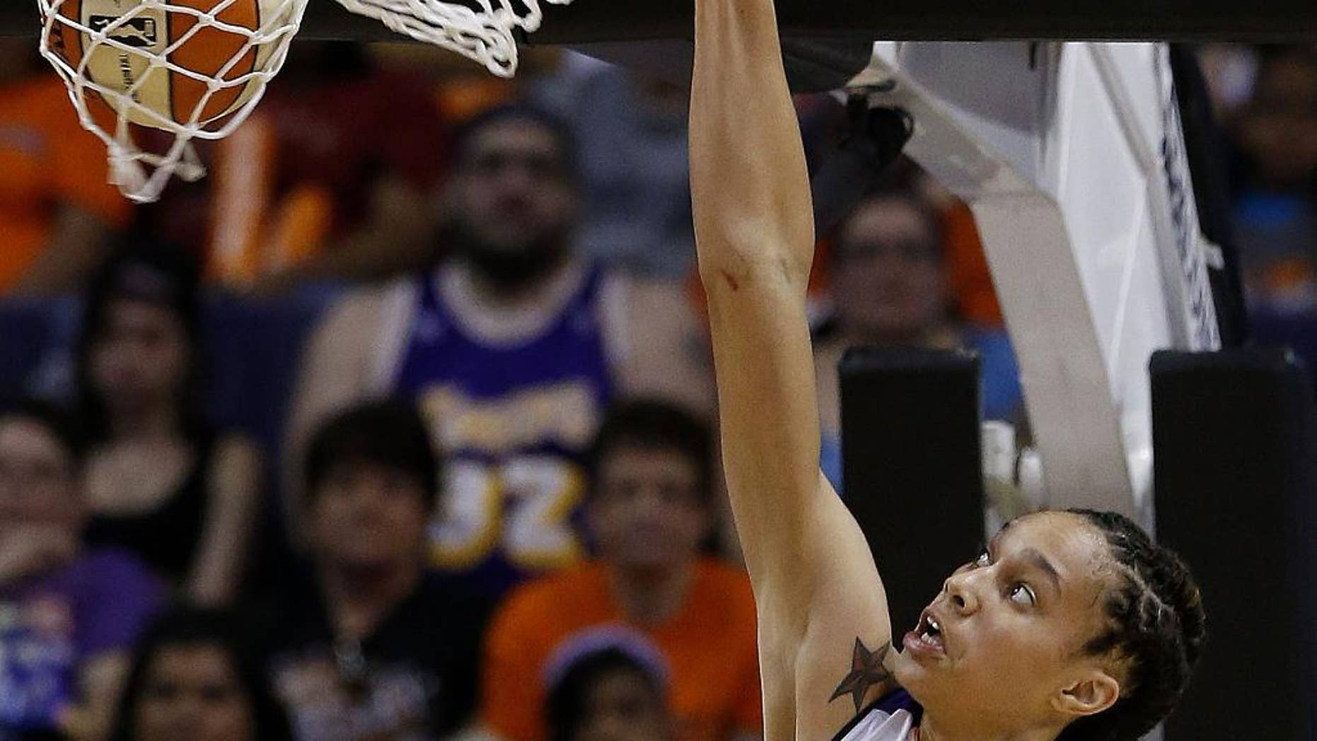 FILE - In this May 27, 2013, file photo, Phoenix Mercury's Brittney Griner dunks against the Chicago Sky in the second half during a WNBA basketball game in Phoenix. Griner brings her slam-dunking skills to Madison Square Garden for the first time, hoping to take her team a step closer to the WNBA playoffs and a possible league record 30-win season.  (AP Photo/Ross D. Franklin, File)