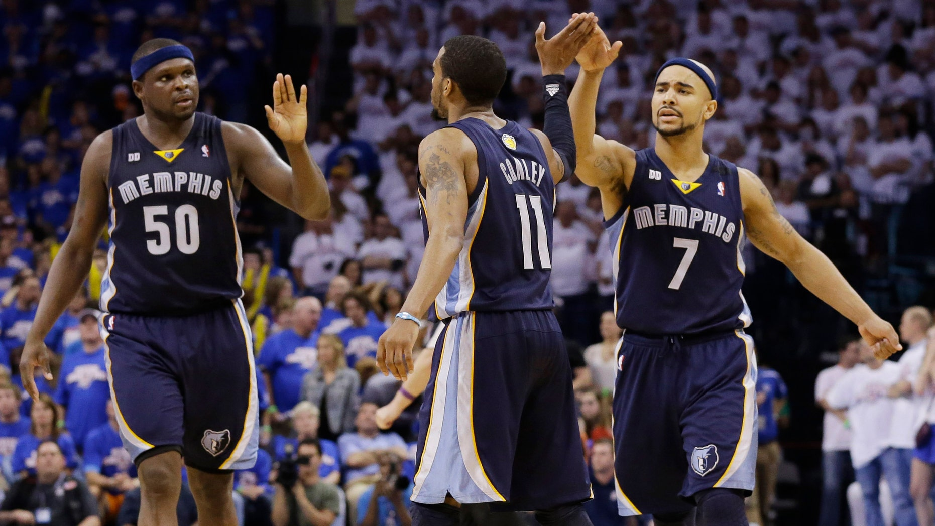 Memphis Grizzlies' Mike Conley (11) celebrates after scoring a basket late in the second half of Game 2 of their Western Conference semifinal NBA basketball playoff series Tuesday, May 7, 2013, in Oklahoma City.
