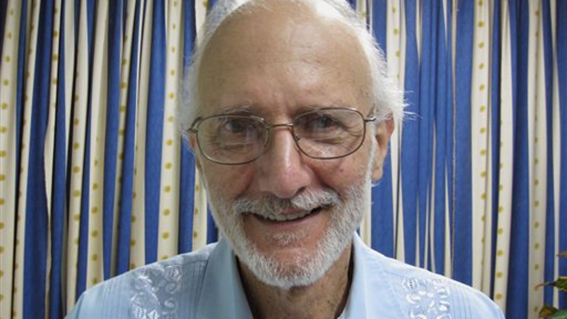 In this file photo provided by U.S. lawyer James L. Berenthal, jailed American Alan Gross poses for a photo during a visit by Rabbi Elie Abadie and Berenthal at Finlay military hospital in Havana, Cuba.