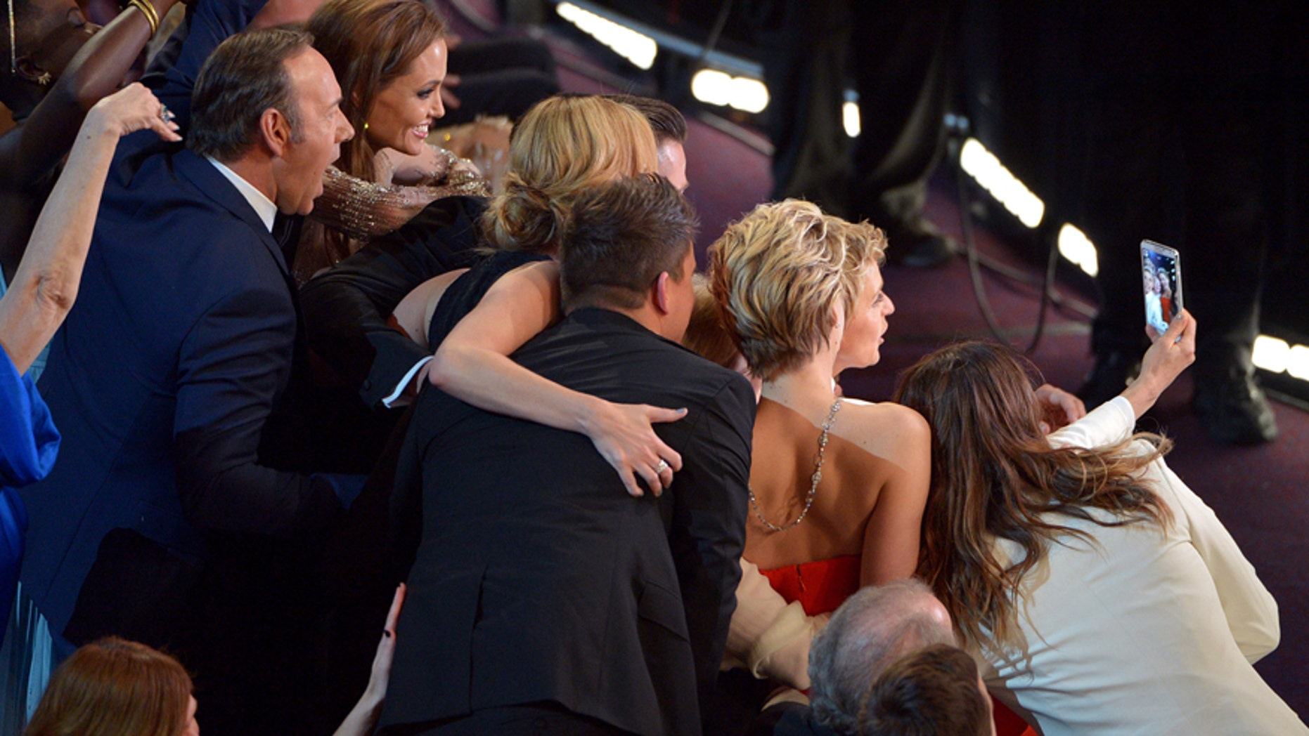 This March 2, 2014 file photo shows Kevin Spacey, from left, Angelina Jolie, Julia Roberts, Brad Pitt, Jennifer Lawrence, Ellen Degeneres and Jared Leto join other celebrities for a group selfie during the Oscars at the Dolby Theatre  in Los Angeles.