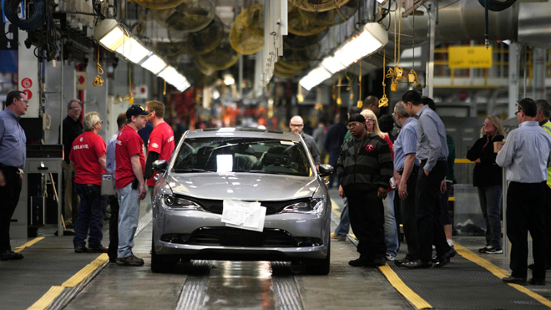STERLING HEIGHTS, MI - MARCH 14: The new 2015 Chrysler 200 comes off the assembly line at the Sterling Heights Assembly Plant March 14, 2014 in Sterling Heights, Michigan. The plant, originally slated for closure in 2010, was transformed by an investment of more than $1 billion and is now one of the Chrysler Group's largest and most technologically advanced, with more than 5 million square feet of manufacturing space. (Photo by Bill Pugliano/Getty Images)