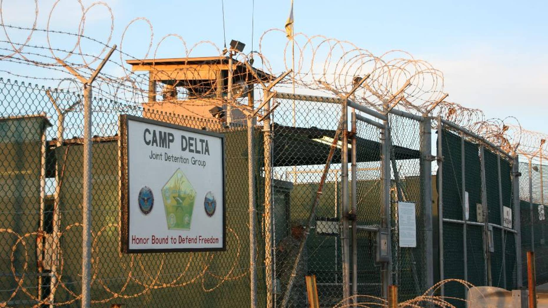 FILE - This Oct. 24, 2010, file photo shows the entrance to Camp Delta at Guantanamo Bay. Six men long held at Guantanamo Bay arrived Saturday, June 13, 2015,  in Oman, the first movement of detainees out of the U.S. prison for terrorism suspects in five months as Congress considers new restrictions on transfers. The six detainees — all from Oman's war-torn Mideast neighbor Yemen — boarded a flight from the U.S. prison in Cuba on Friday, bringing Guantanamo's population down to 116. The move means President Barack Obama has now transferred more than half of the 242 detainees who were at Guantanamo when he was sworn into office after campaigning to close it. (AP Photo/The Canadian Press, Colin Perkel)