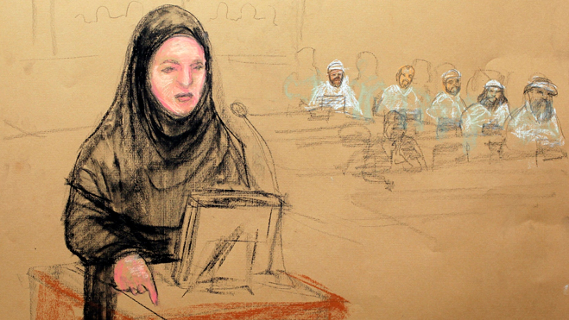 May 5, 2012: In this photo of a sketch by courtroom artist Janet Hamlin and reviewed by the U.S. Department of Defense, Pentagon paid civilian defense lawyer Cheryl Borman, defense attorney of accused Sept. 11 co-conspirator Walid bin Attash, argues a point during the military hearing at the Guantanamo Bay U.S. Naval Base in Cuba.