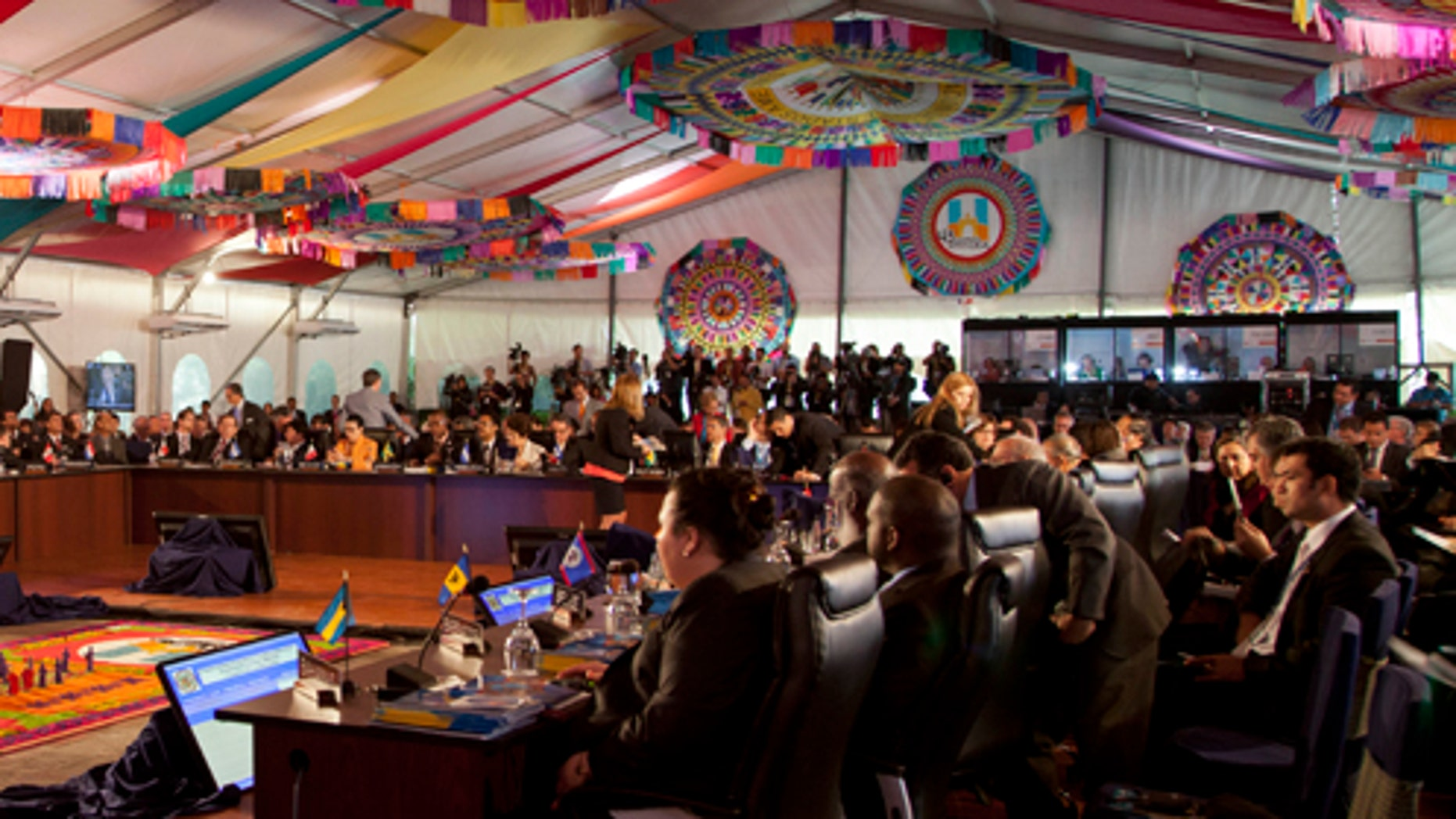 Delegates meet for the first session of the 43rd General Assembly of the Organization of American States, OAS, in Antigua Guatemala, Guatemala, Wednesday, June 5, 2013. Latin American countries frustrated by the United States' refusal to change its drug war strategy will push at the OAS conference that began Tuesday for the U.S. government to start discussing alternative approaches to a fight that has killed tens of thousands in a region beset by drug cartels. (AP Photo/Moises Castillo)