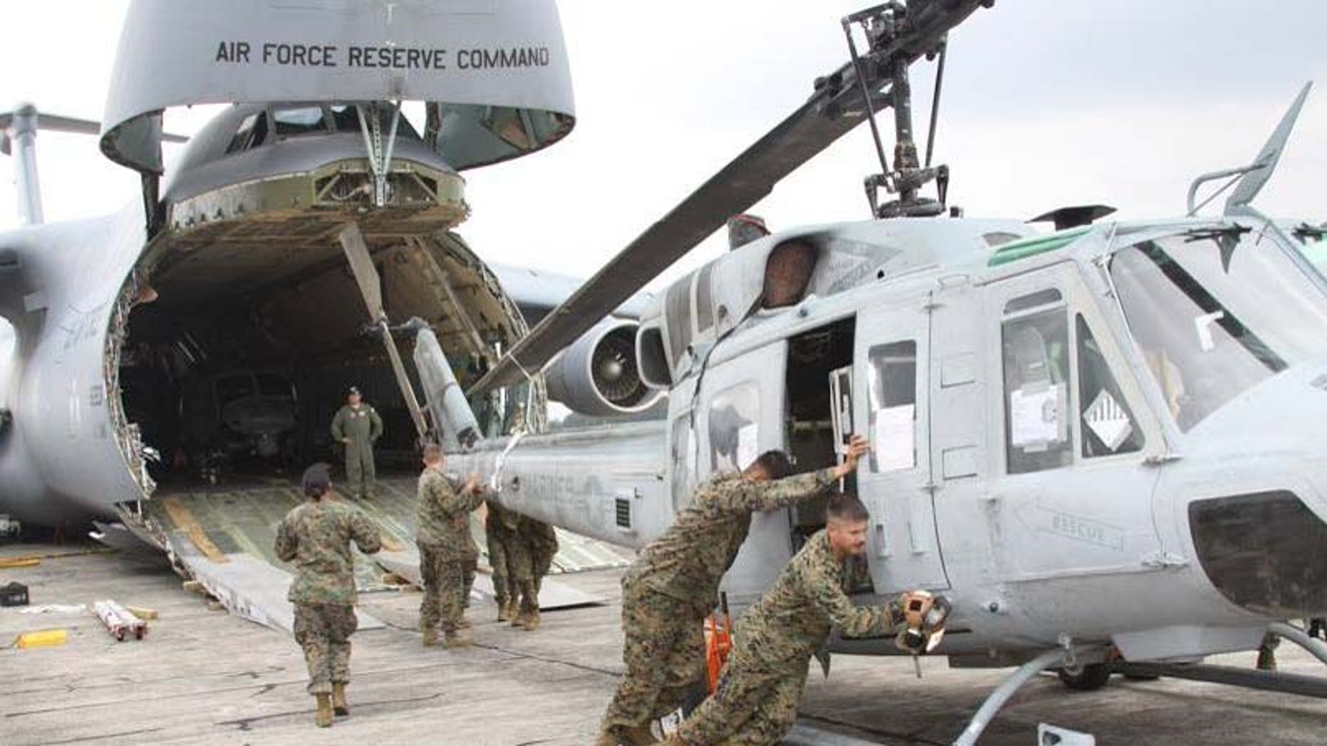 In this image released by the U.S. Marine Corps on Wednesday Aug. 29, 2012,  Marines from Marine Light Attack Helicopter Squadron 467 (HMLA-467) unload a UH-1N Huey helicopter in Guatemala City, Aug. 11, 2012.  A team of 200 U.S. Marines and four UH-1N Huey helicopters has begun patrolling Guatemala's western coast this week in what a military spokesman says is an unprecedented operation, code named Operation Martillo,  to beat drug traffickers in the Central America region. (AP Photo/U.S. Marine Corps)