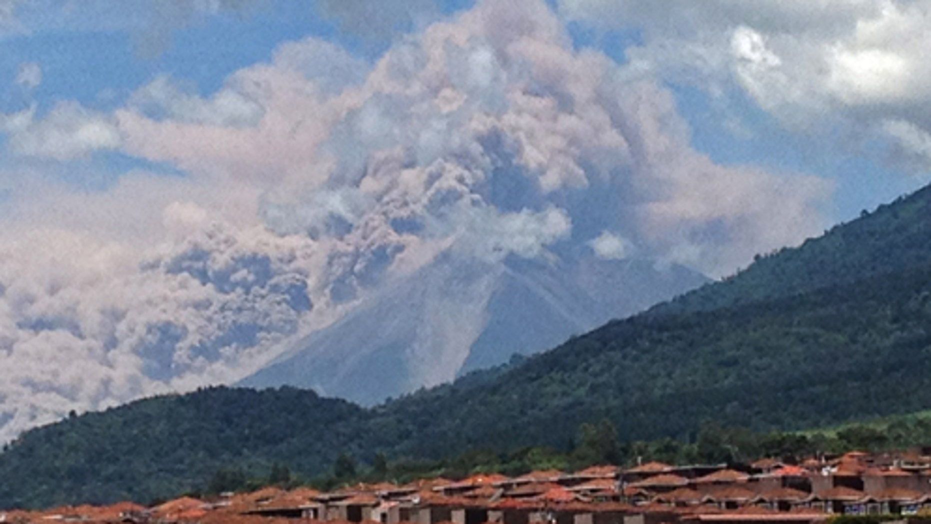 In this image with a cell phone plumes of smoke rise from the Volcan de Fuego or Volcano of Fire spews ash seen from Palin, south of Guatemala City, Thursday, Sept. 13, 2012. The volcano is spewing lava and ash and the director of the national disaster agency says officials are carrying out âa massive evacuation of thousands of peopleâ in five communities. (AP Photo/Moises Castillo)