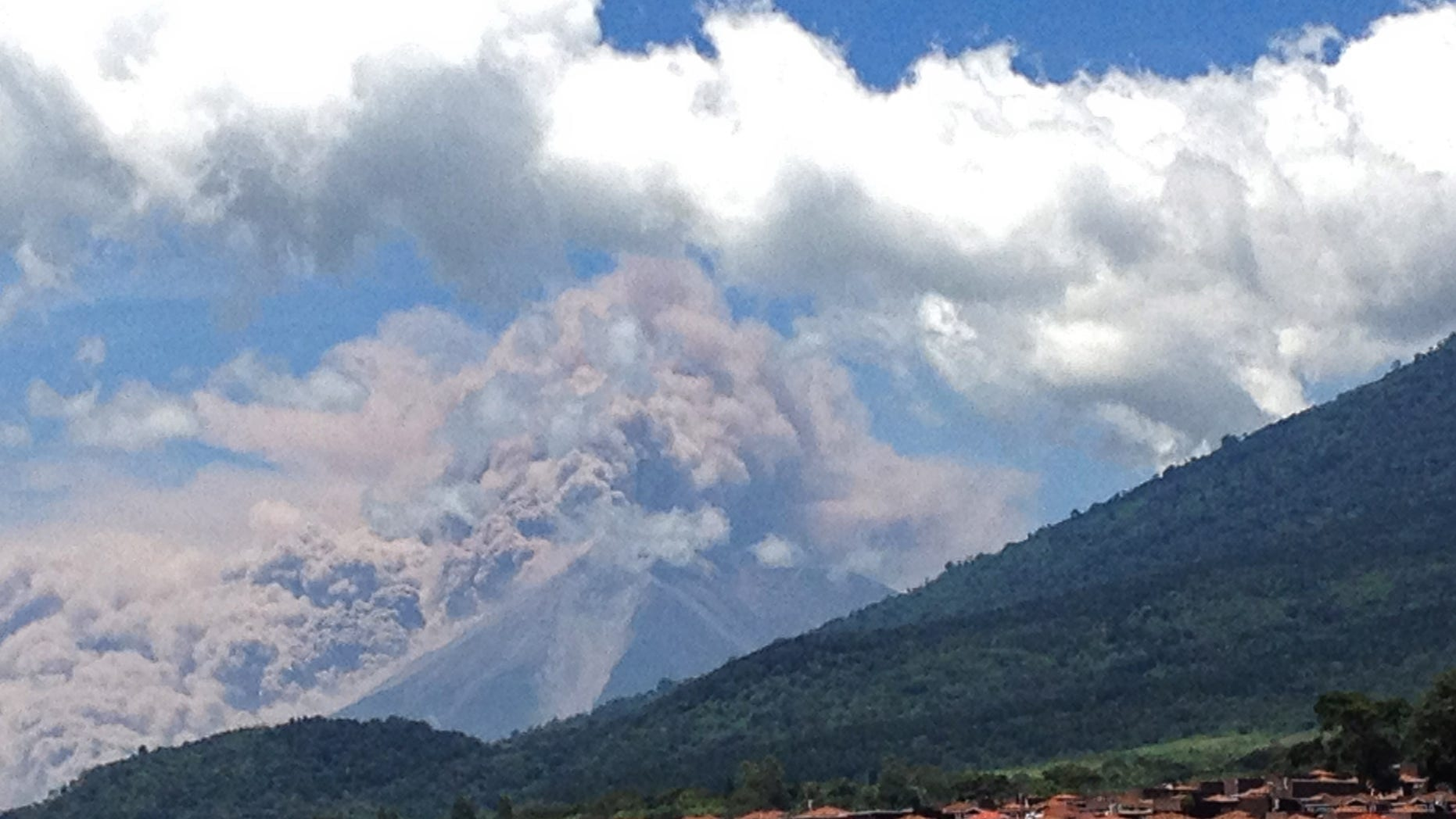 Sept. 13, 2012: In this image with a cell phone plumes of smoke rise from the Volcan de Fuego or Volcano of Fire spews ash seen from Palin, south of Guatemala City.